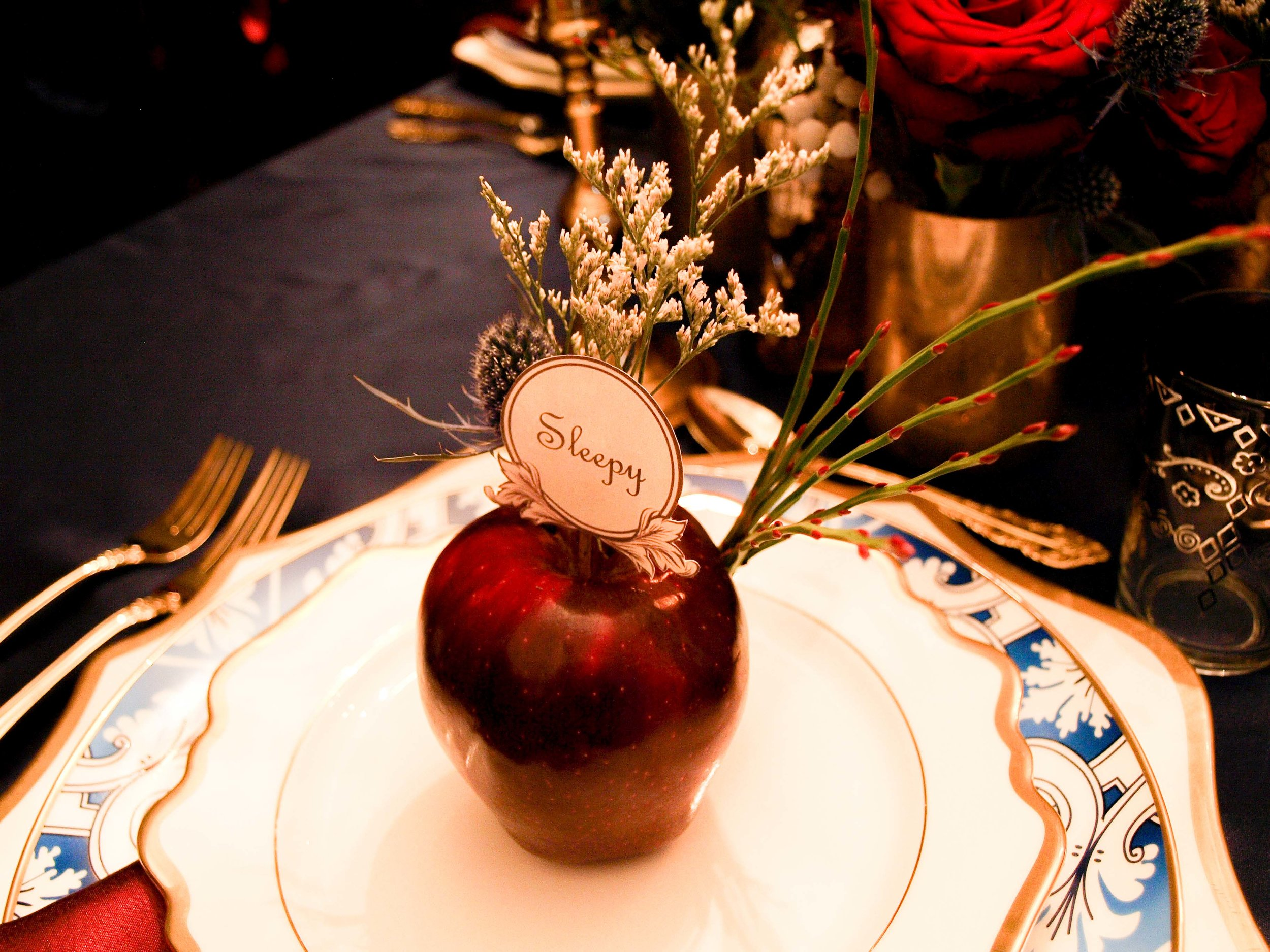 Snow White and the Seven Dwarves Decor and Floral Inspiration - Enchanted Dark Forest Tablescape Red Delicious Apple Place Card - Historia Wedding and Event Planning