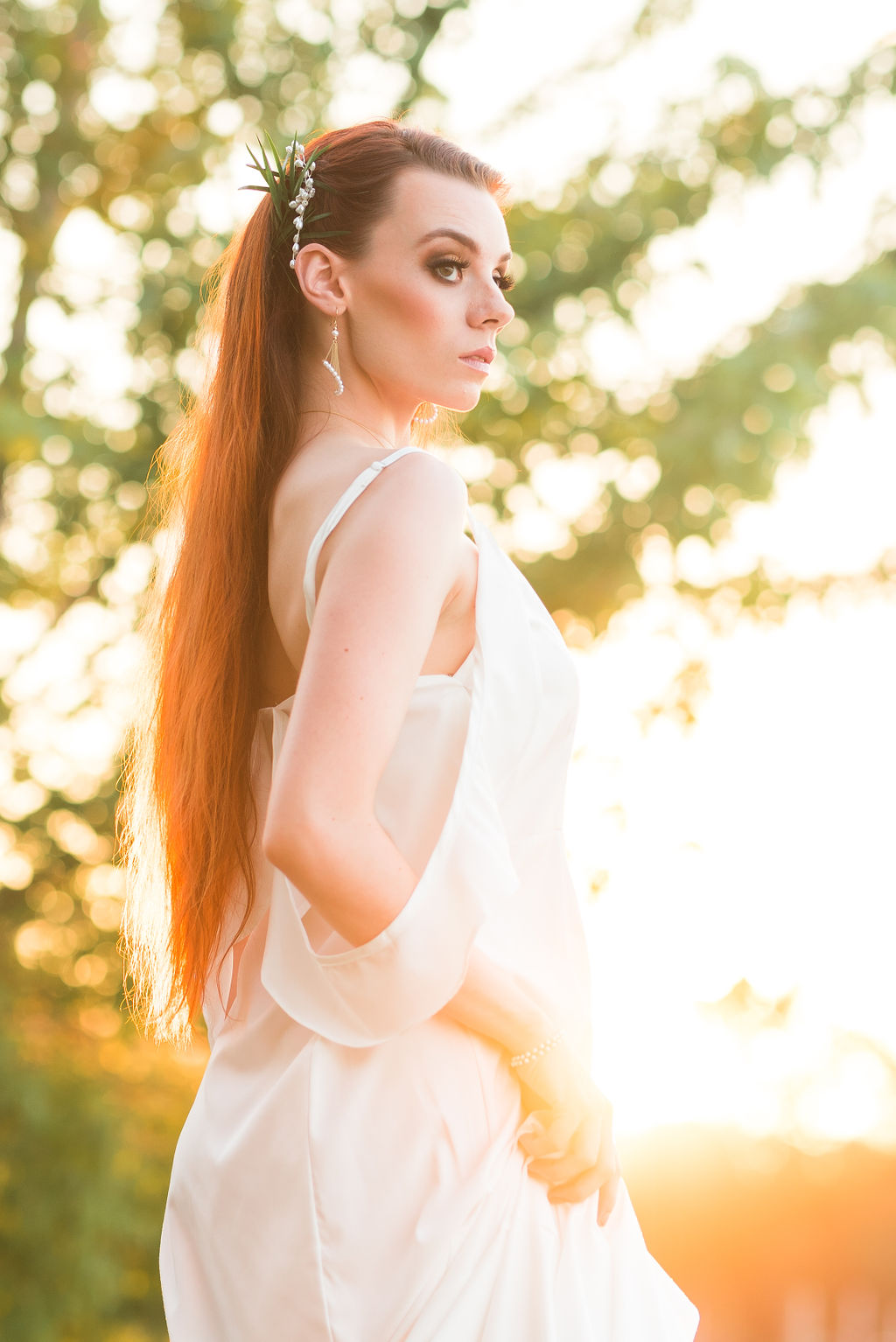 bohemian chic bride in flowy white gown against the sunset