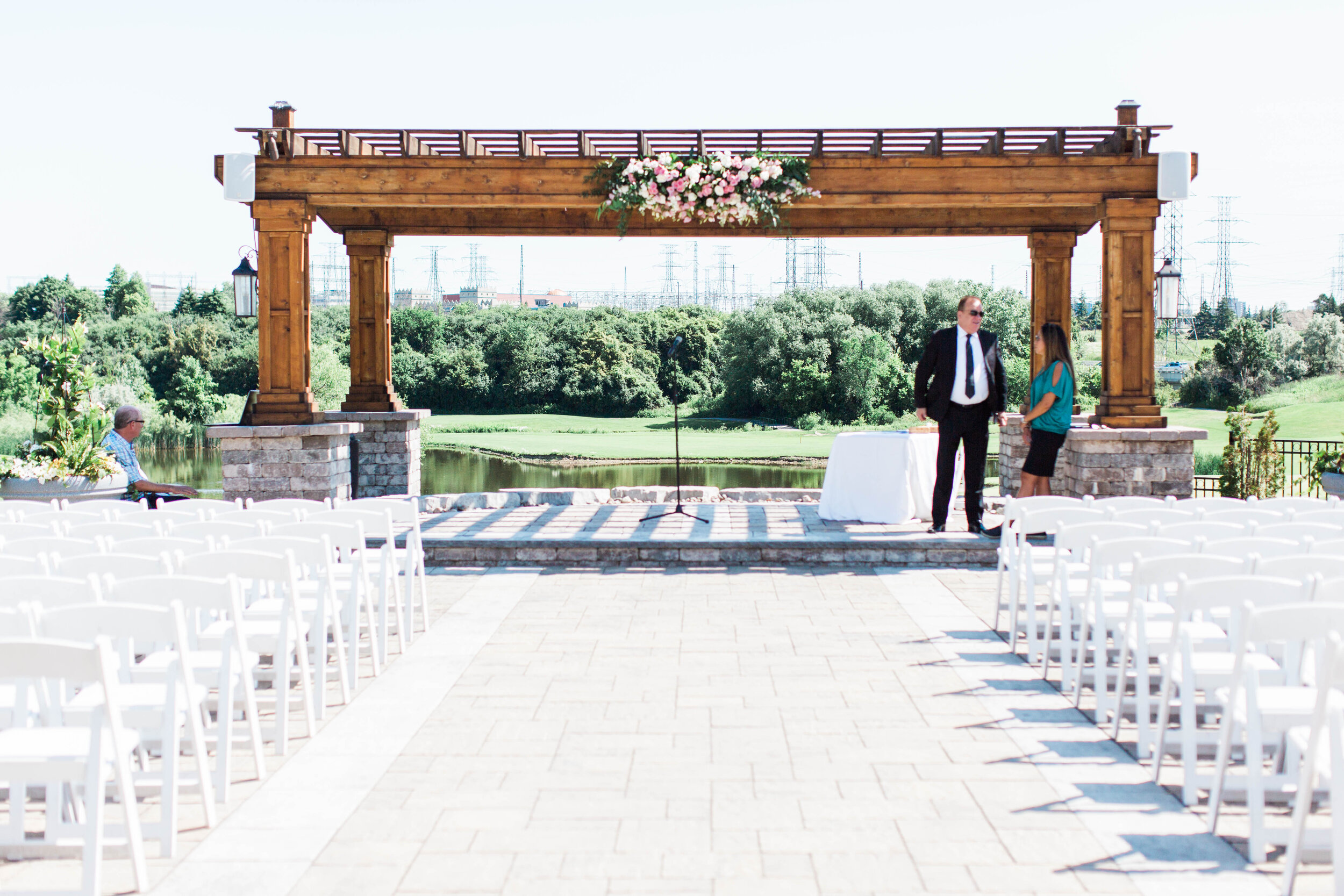 Large Wood Ceremony Arbour with decor setup - Trendy Modern Brunch Wedding - Historia Wedding and Event Planning