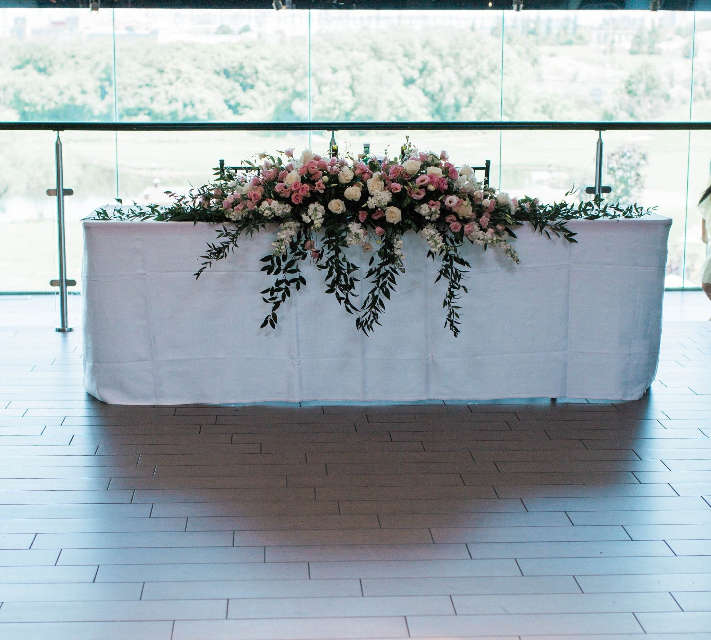 Head table sweetheart table with pink and white arrangement - Trendy Modern Brunch Wedding - Historia Wedding and Event Planning