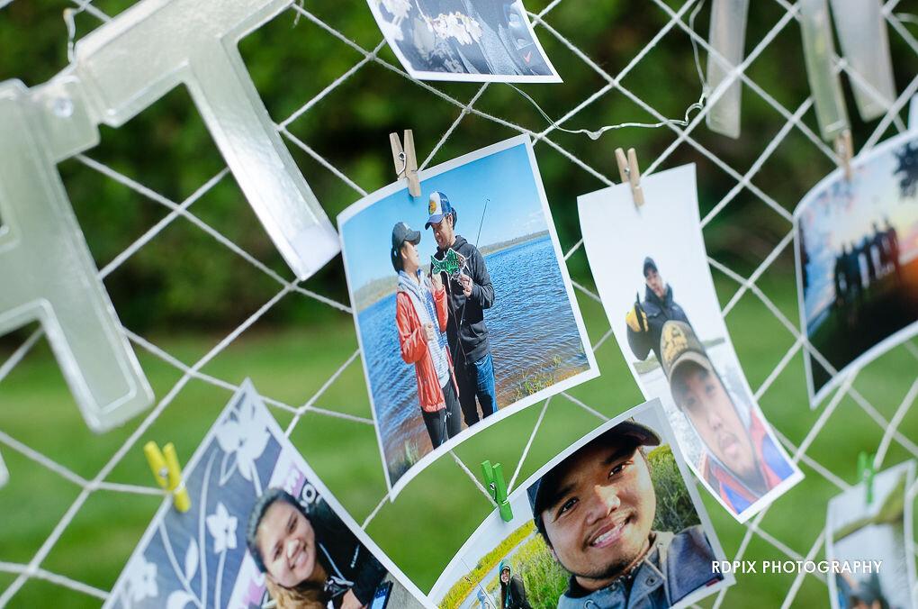 Fishing net with photos - DIY Fishing Themed Backyard Wedding - Historia Wedding and Event Planning