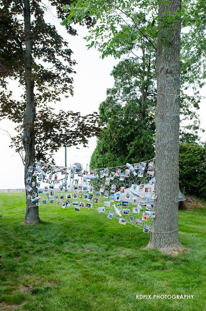 Fishing net DIY photo display - DIY Fishing Themed Backyard Wedding - Historia Wedding and Event Planning