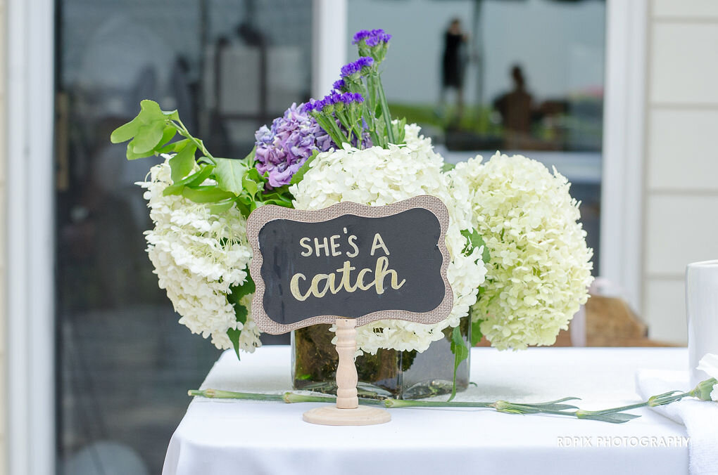 She's a Catch Fishing themed wedding decor - DIY Fishing Themed Backyard Wedding - Historia Wedding and Event Planning
