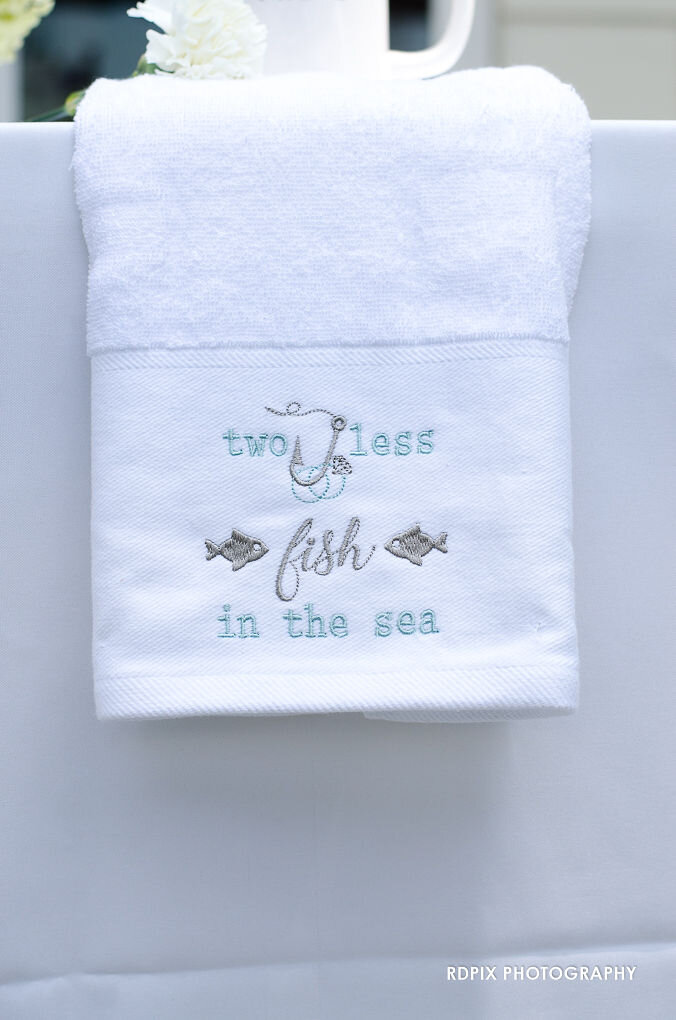 Two less fish in the sea serviette - DIY Fishing Themed Backyard Wedding - Historia Wedding and Event Planning