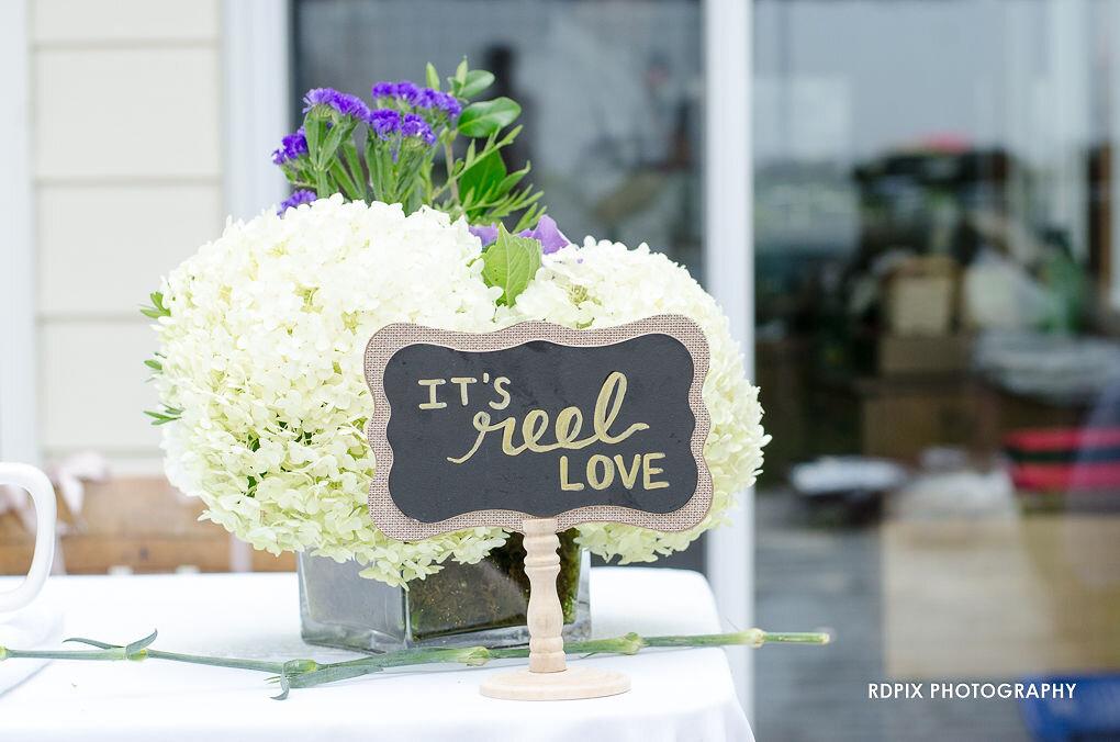 It's Reel Love sweetheart table decor - DIY Fishing Themed Backyard Wedding - Historia Wedding and Event Planning