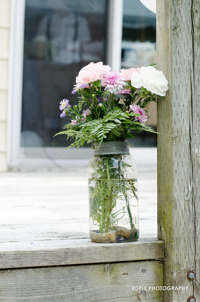 Mason jar flower arrangement - DIY Fishing Themed Backyard Wedding - Historia Wedding and Event Planning