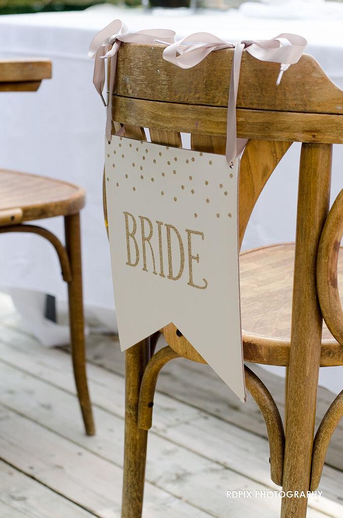 Bride's chair sweetheart table decor - DIY Fishing Themed Backyard Wedding - Historia Wedding and Event Planning