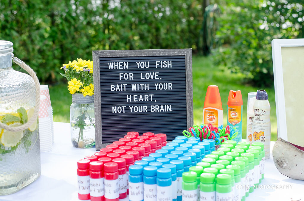 Receiving table sign and bubbles - DIY Fishing Themed Backyard Wedding - Historia Wedding and Event Planning