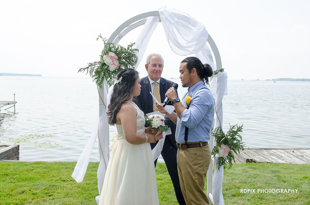 Lakeside ceremony with DIY wedding arbour - DIY Fishing Themed Backyard Wedding - Historia Wedding and Event Planning
