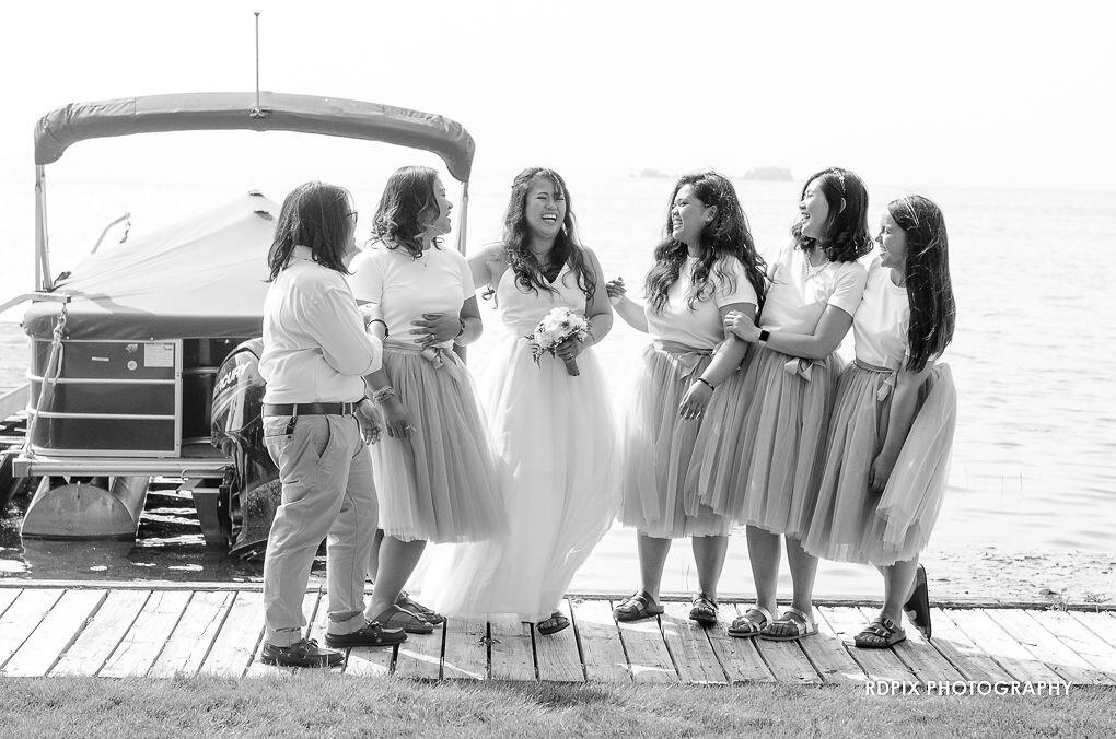 Bridesmaid lakeside photo - DIY Fishing Themed Backyard Wedding - Historia Wedding and Event Planning