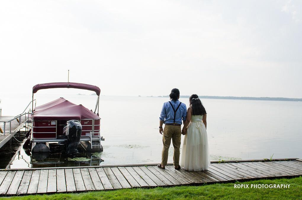 Bride and groom lakeside photo - DIY Fishing Themed Backyard Wedding - Historia Wedding and Event Planning
