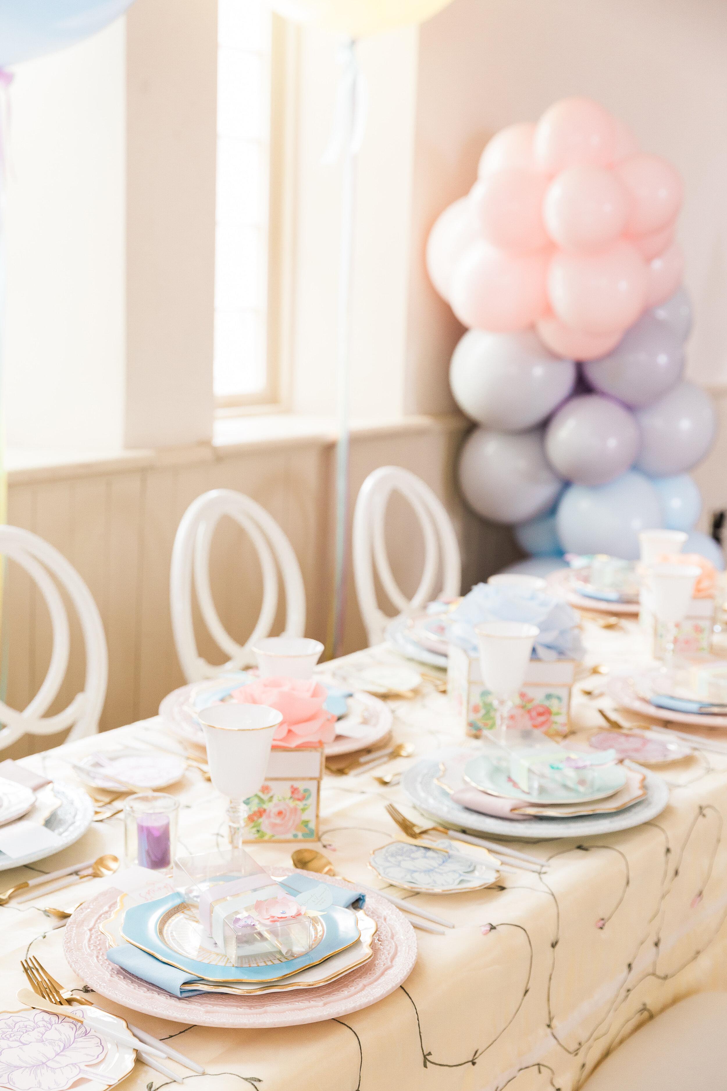pastel rainbow wedding guest reception table