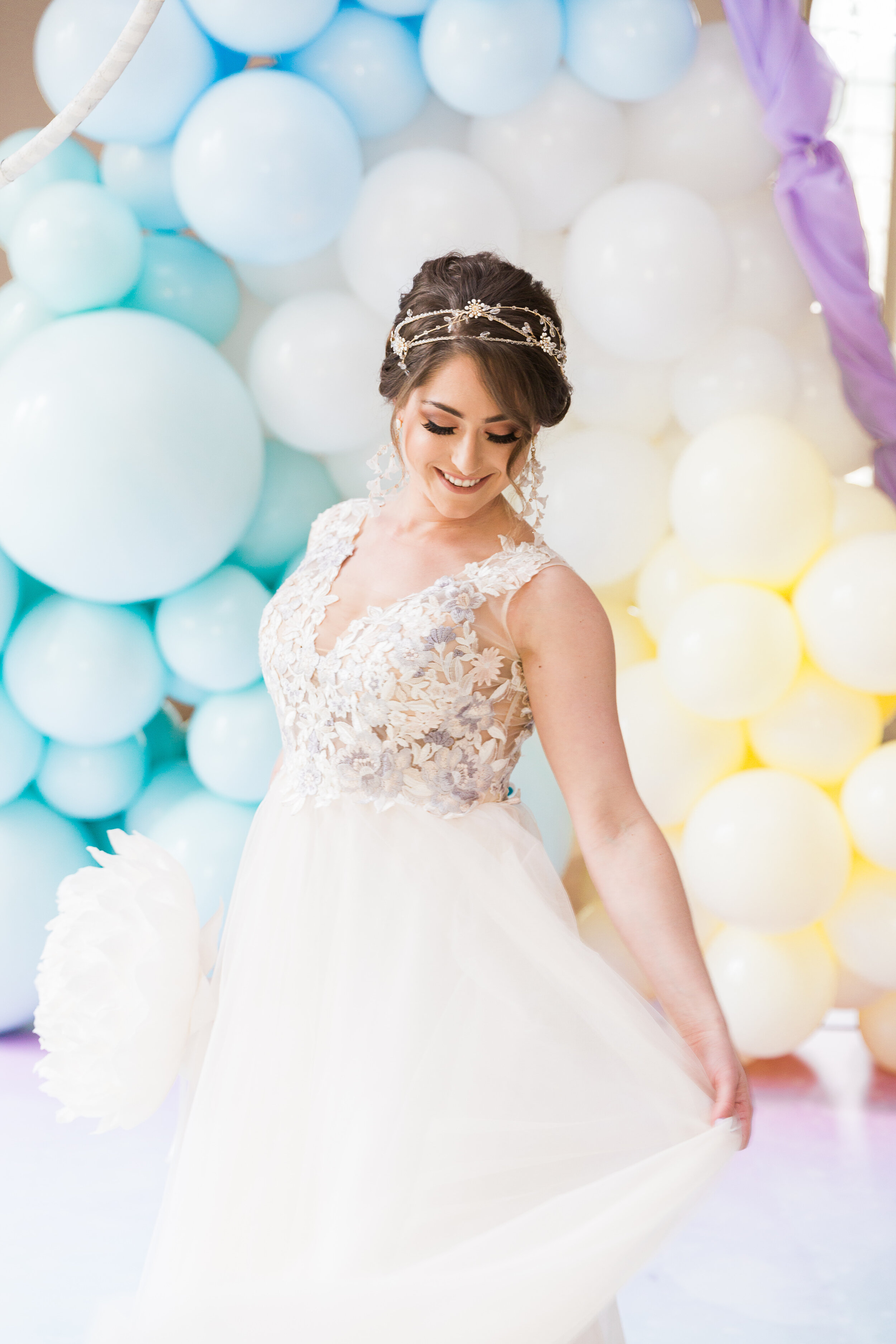 happy whimsical bride with balloon back drop - Samantha Ong Photography