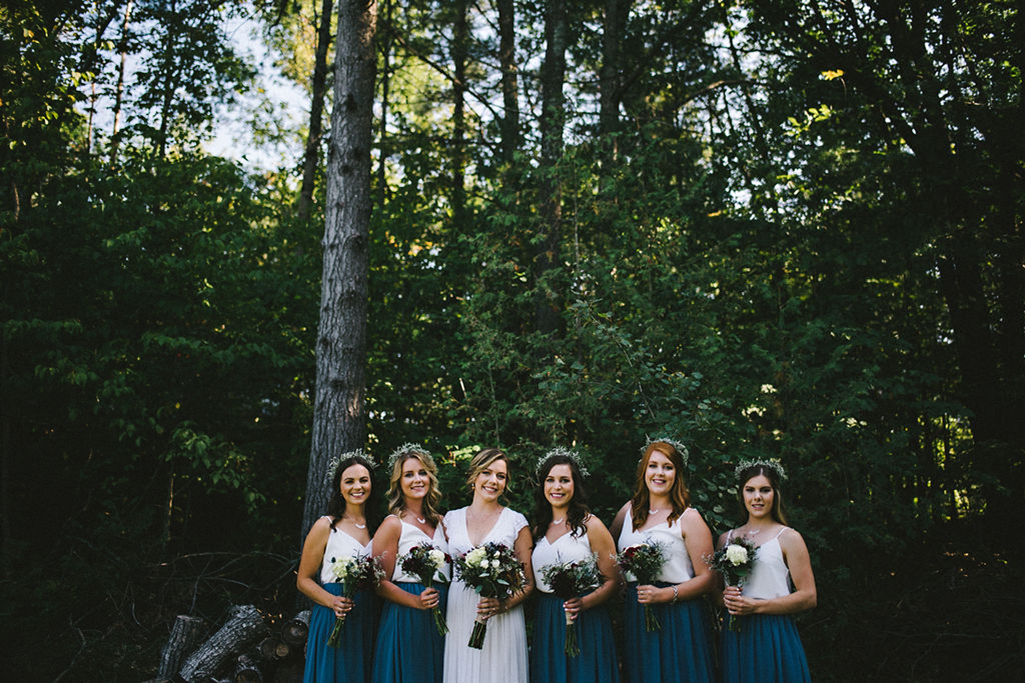 Bridal party wearing two tone separates at camp wedding in Parry