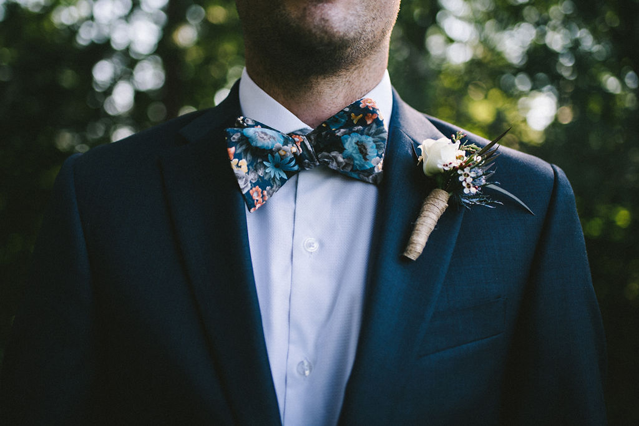Floral bowtie groom style at camp wedding in Parry Sound