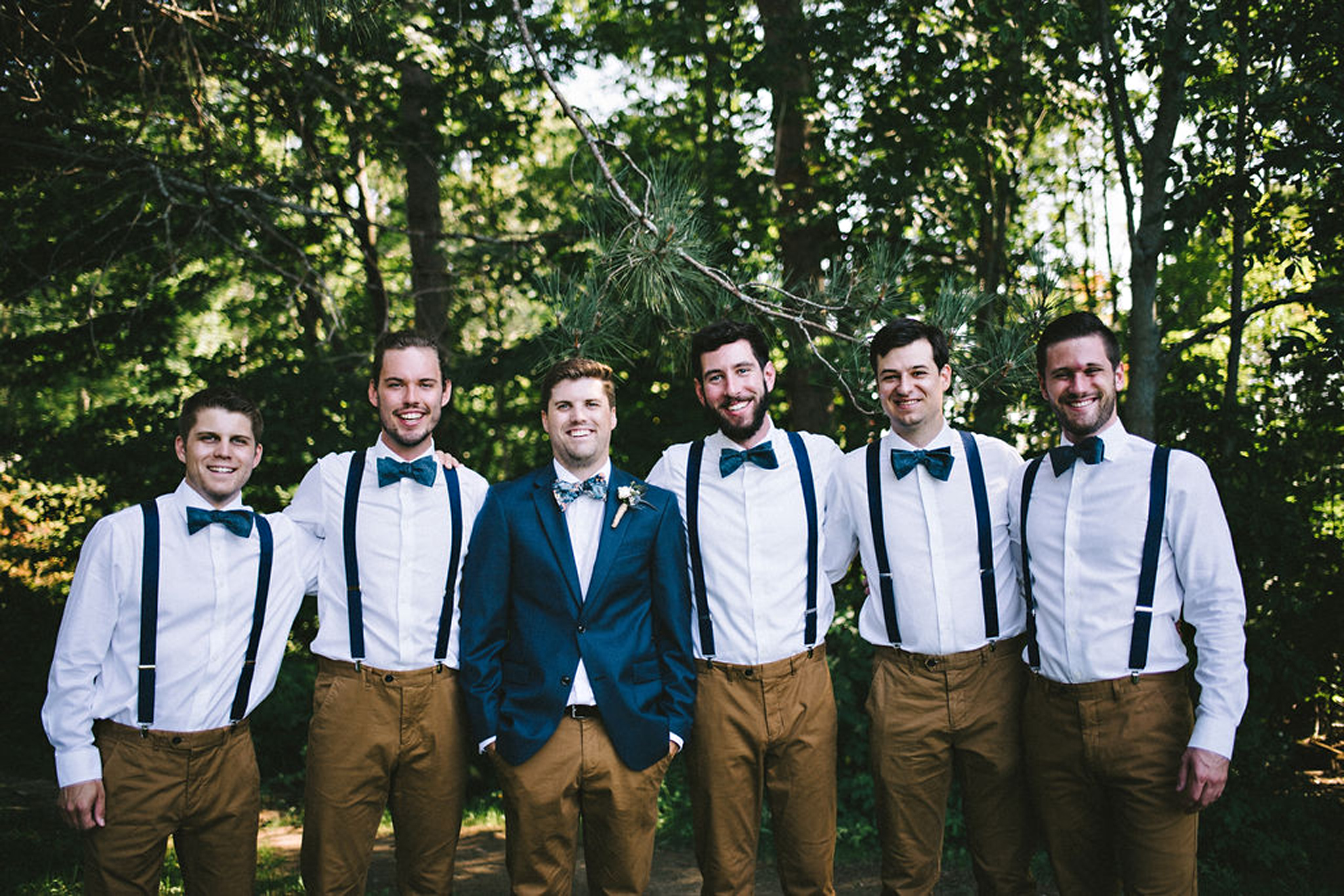 Groomsmen style in bowties and suspenders at Parry Sound camp we