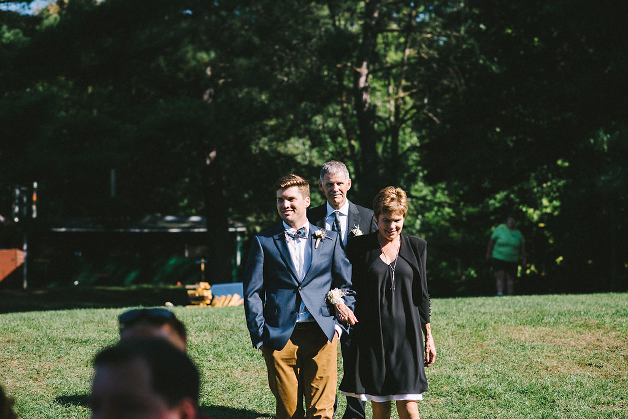 Groom arriving at Parry Sound camp wedding ceremony by lake