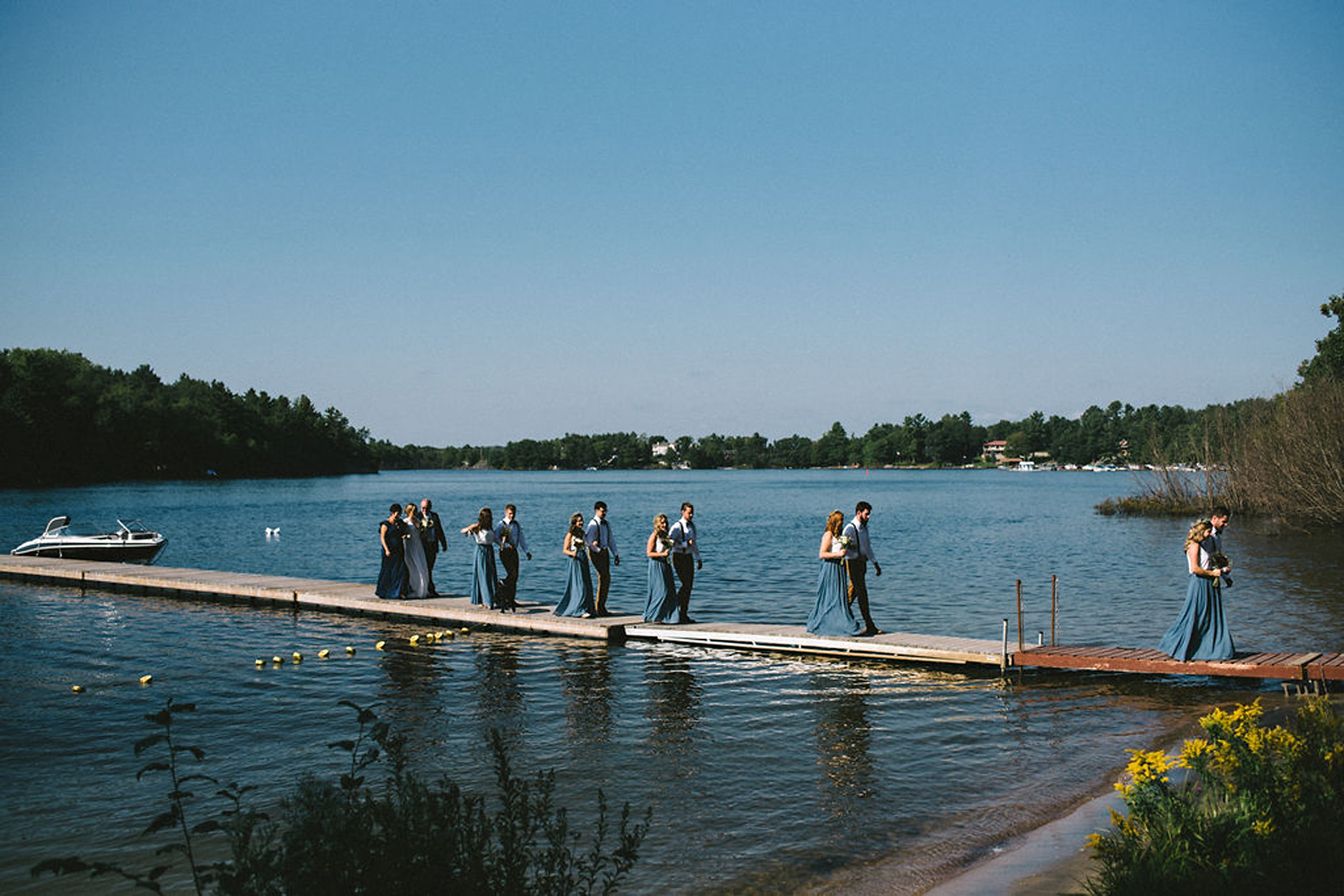 Wedding party arriving by boat at Parry Sound camp wedding