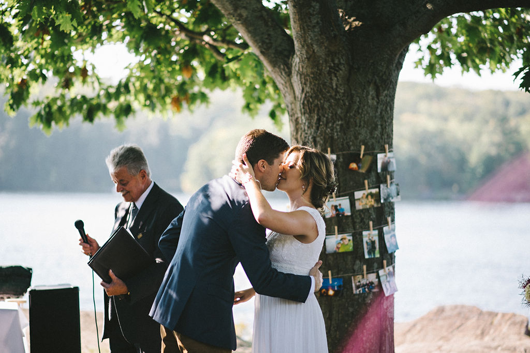 First kiss during lakeside Parry Sound camp wedding