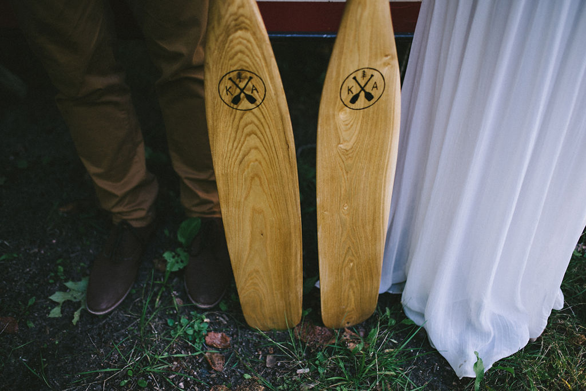 Custom canoe paddles at Parry Sound camp wedding