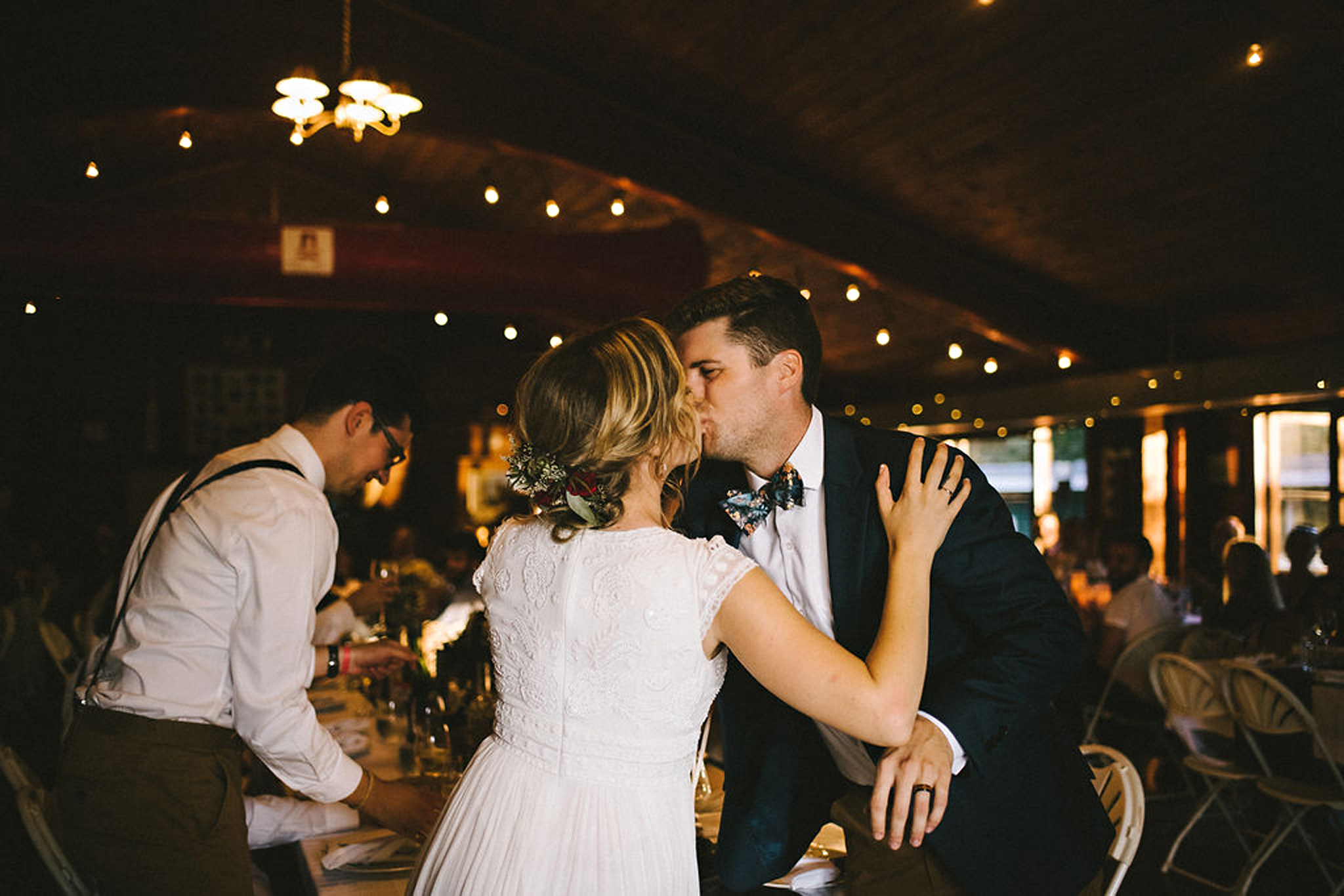 Bride and Groom kiss at Parry Sound camp wedding reception