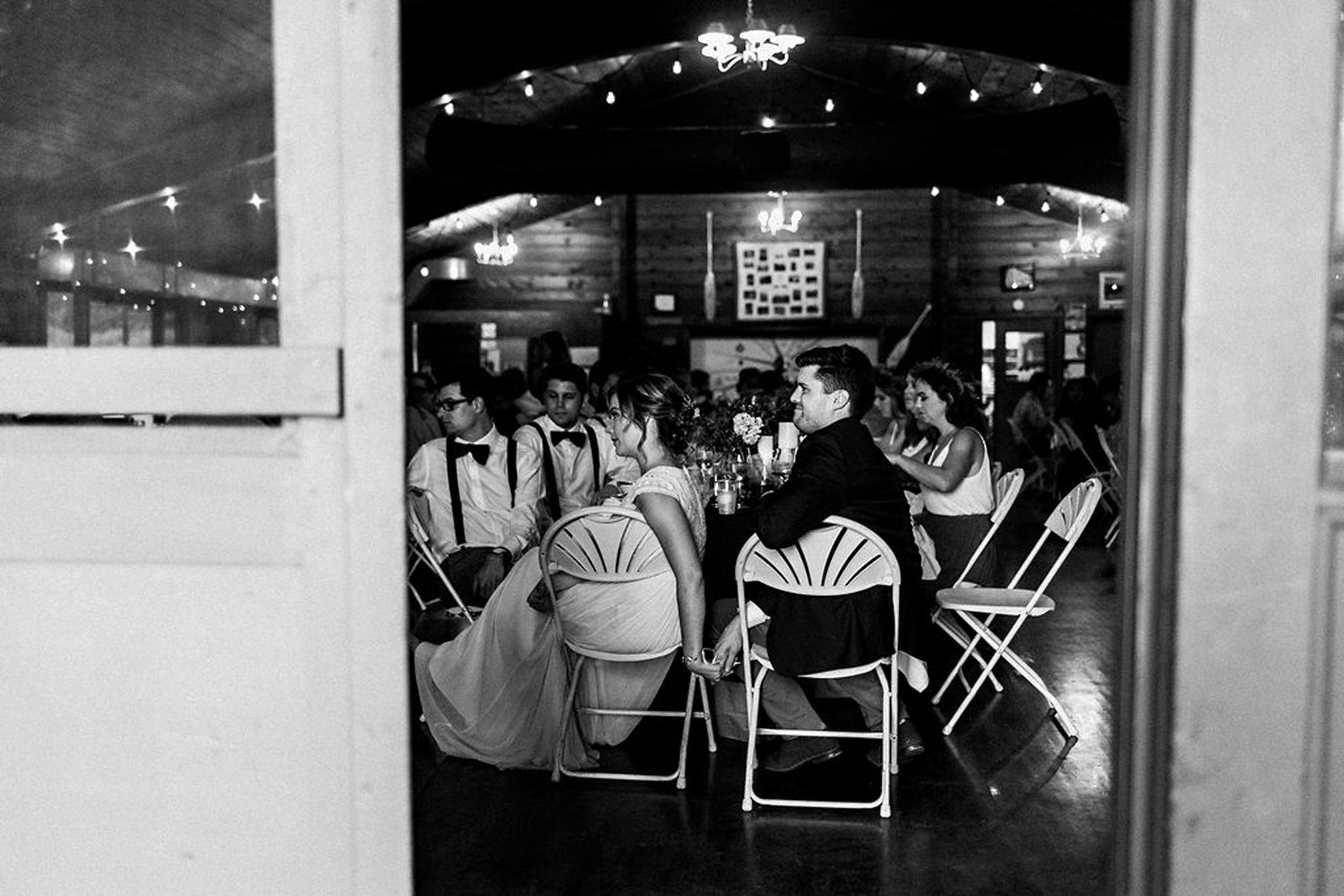 Couple holding hands during speeches at Parry Sound camp wedding
