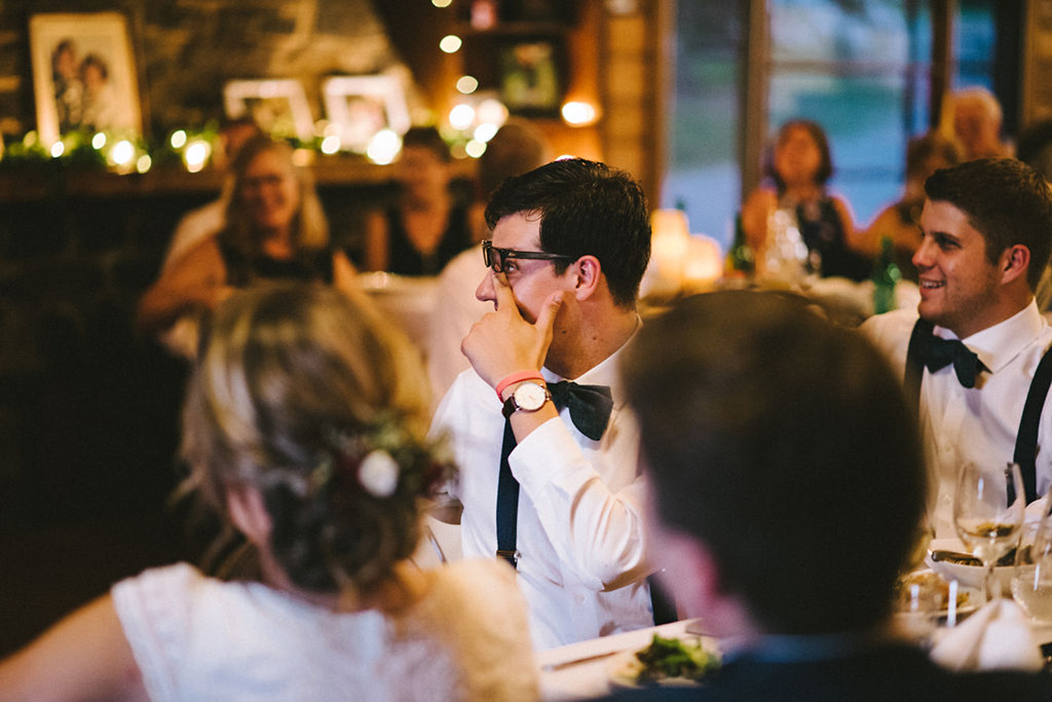 Emotional groomsmen during speeches at Parry Sound camp wedding