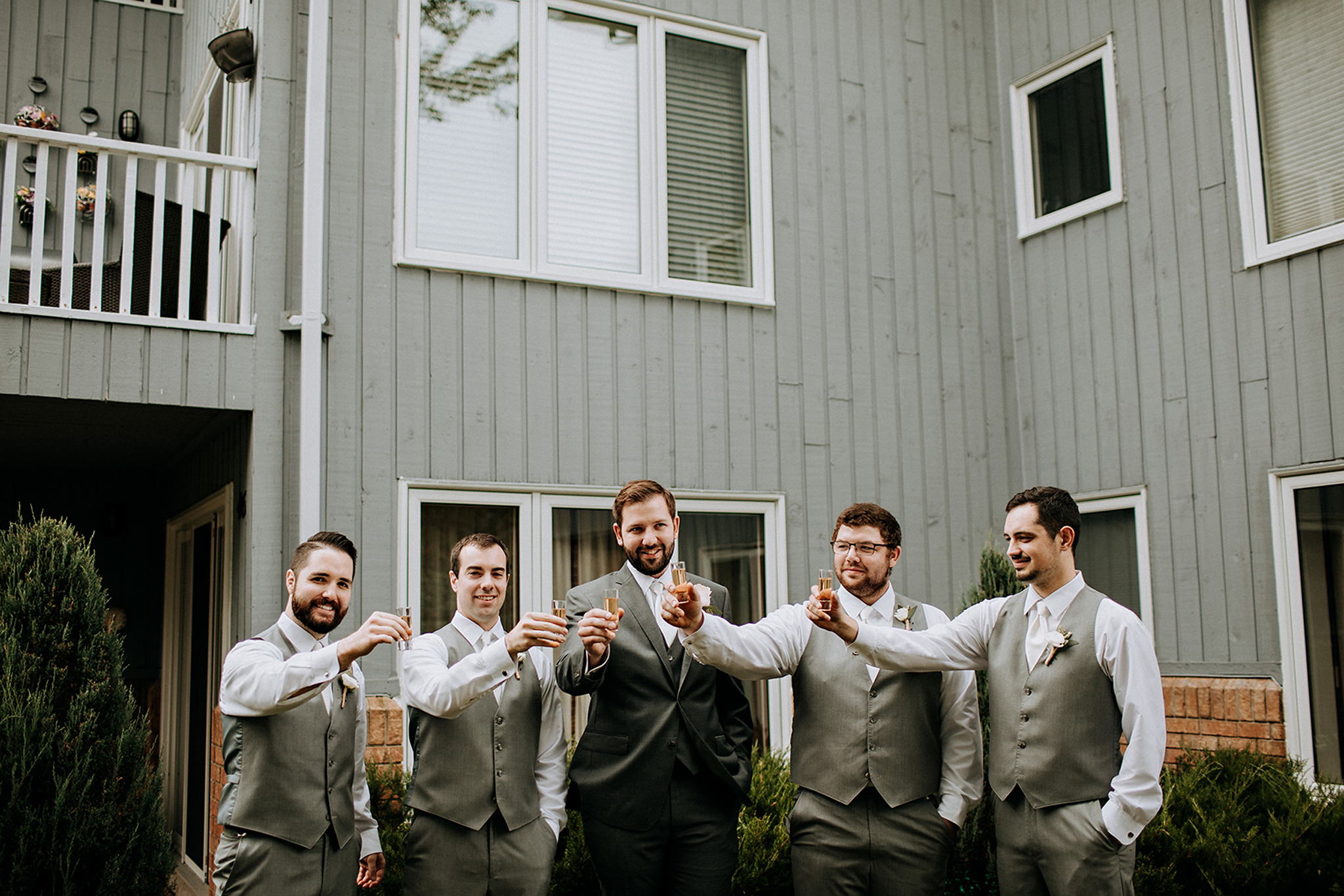 groomsmen toasting at meaford barn wedding