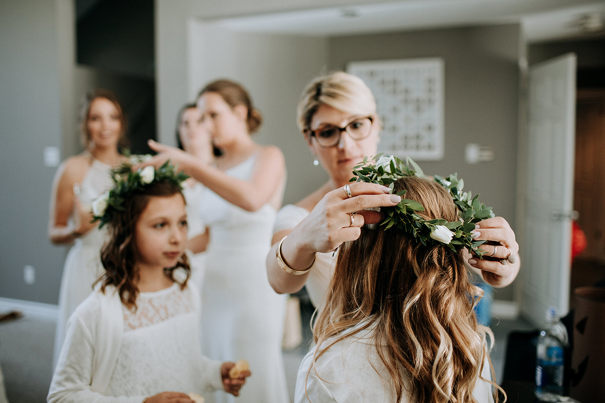 flower girls getting flower crown adjusted at meaford barn weddi