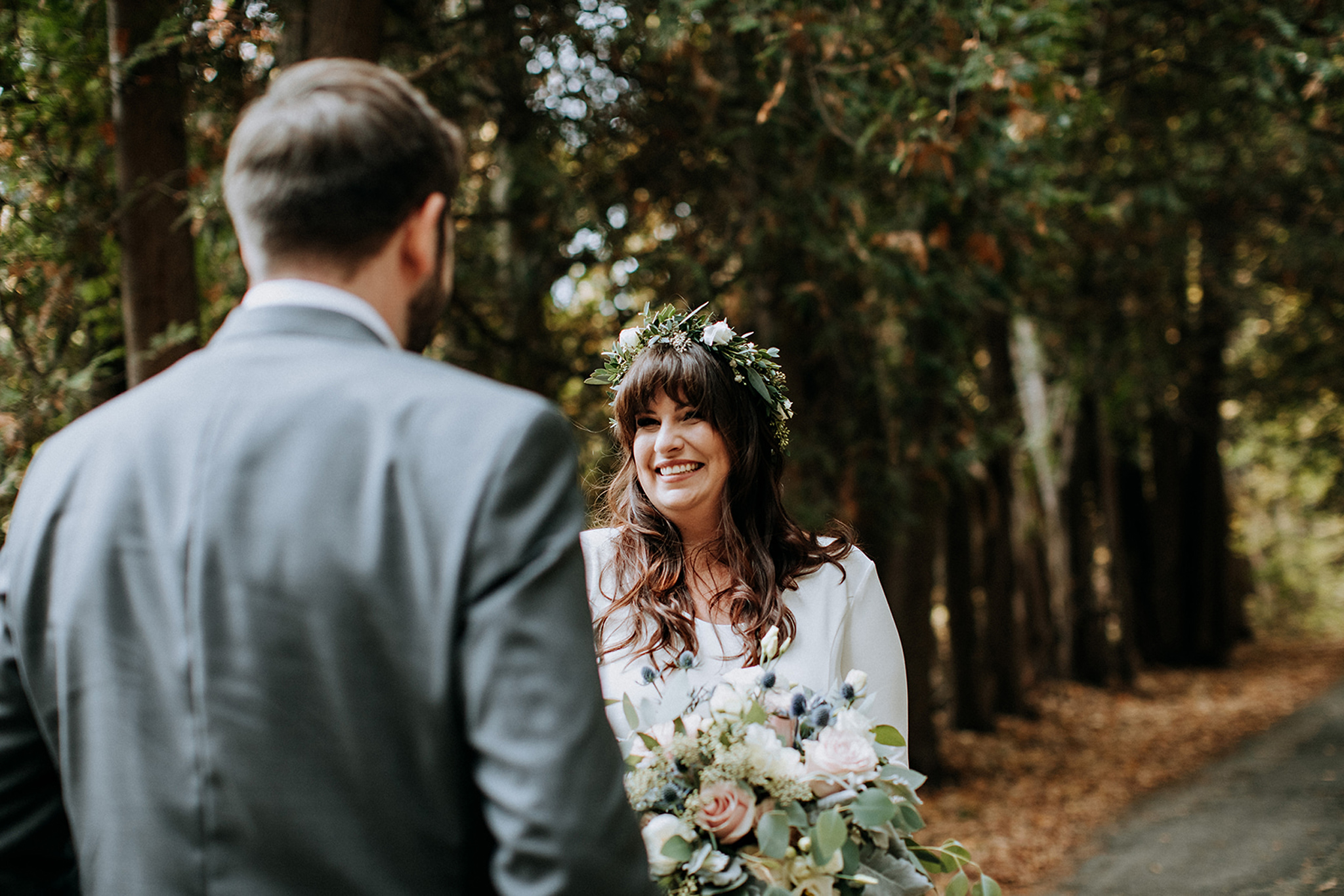 boho bride full of joy during first look at meaford barn wedding
