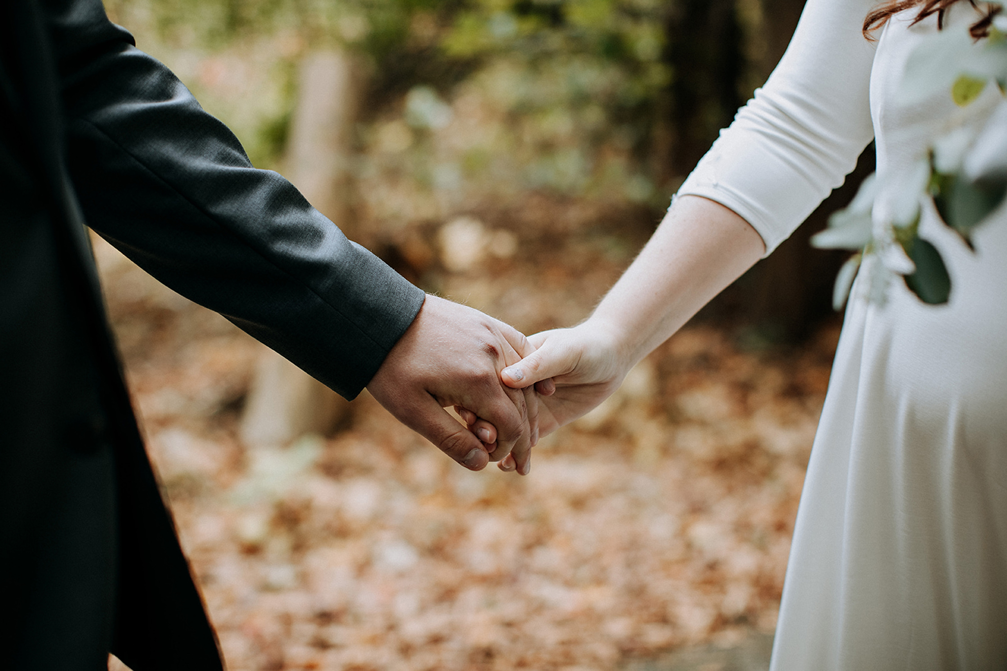 couple holding hands during first look at meaford barn wedding