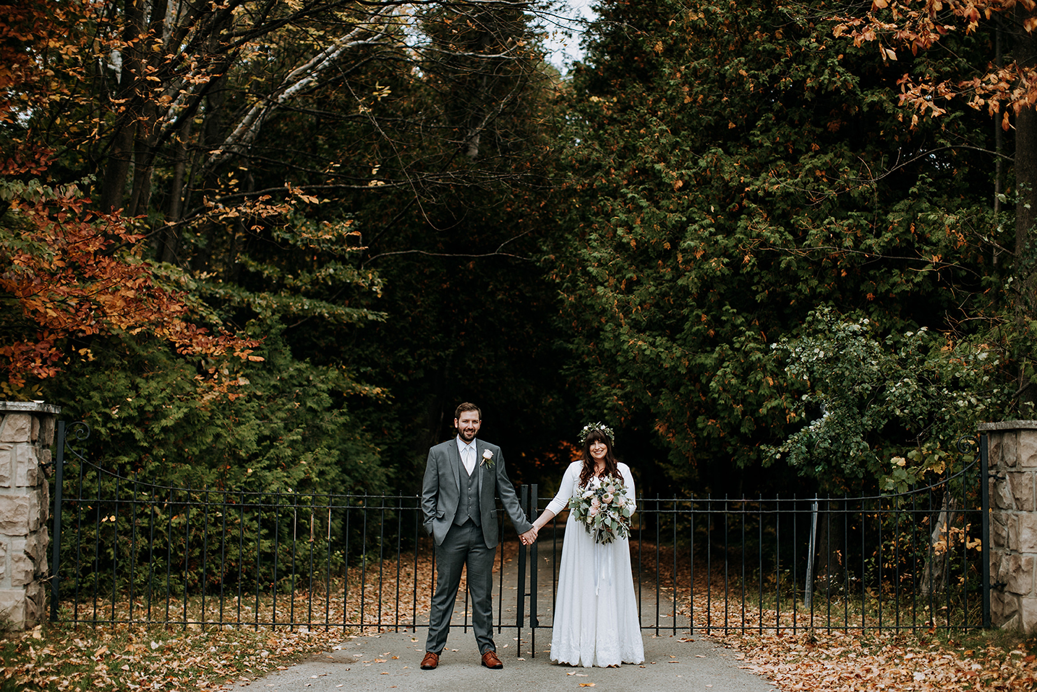 couples portrait with autumn leaves at meaford barn wedding