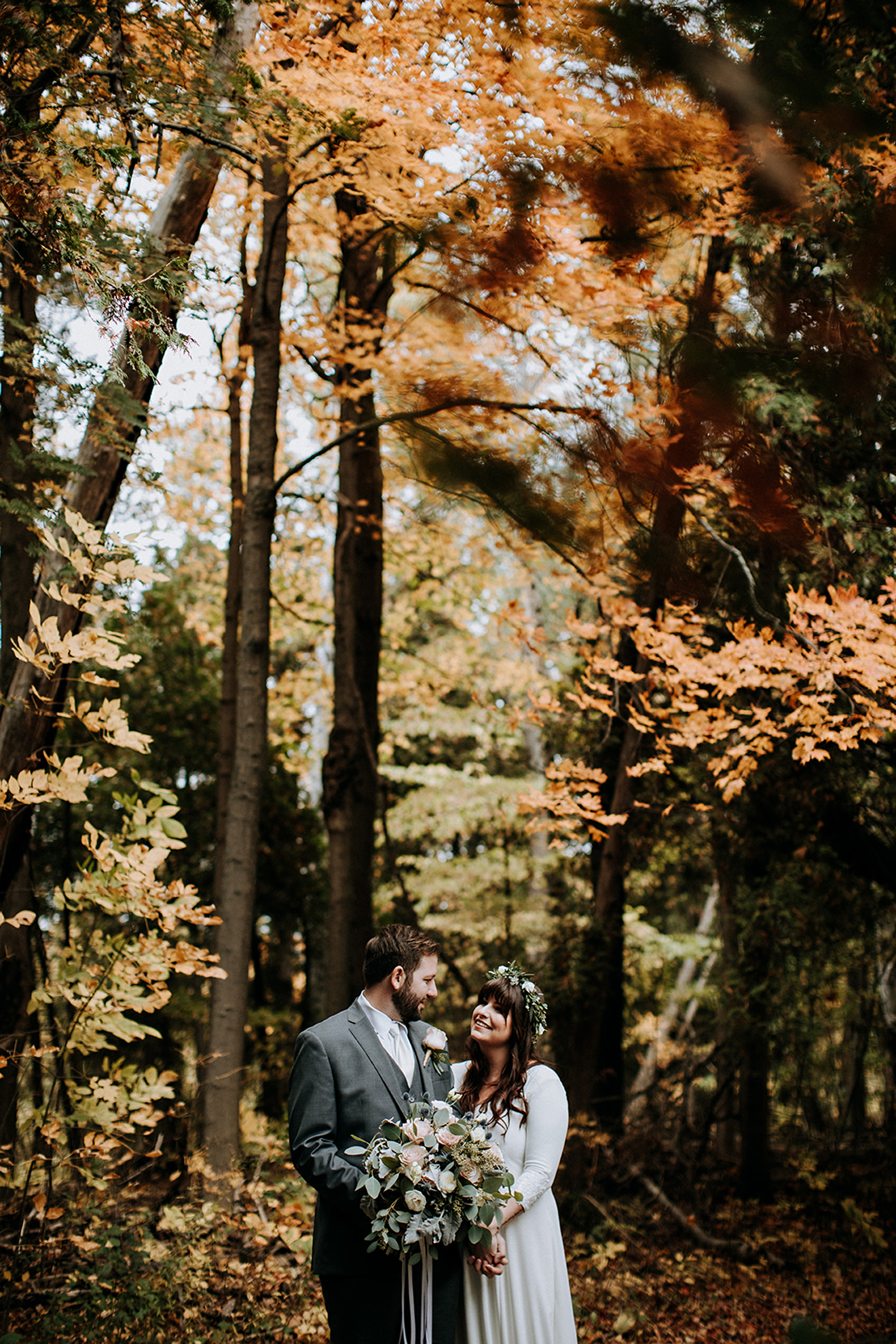 autumn leaves and a beautiful boho couple at meaford barn weddin