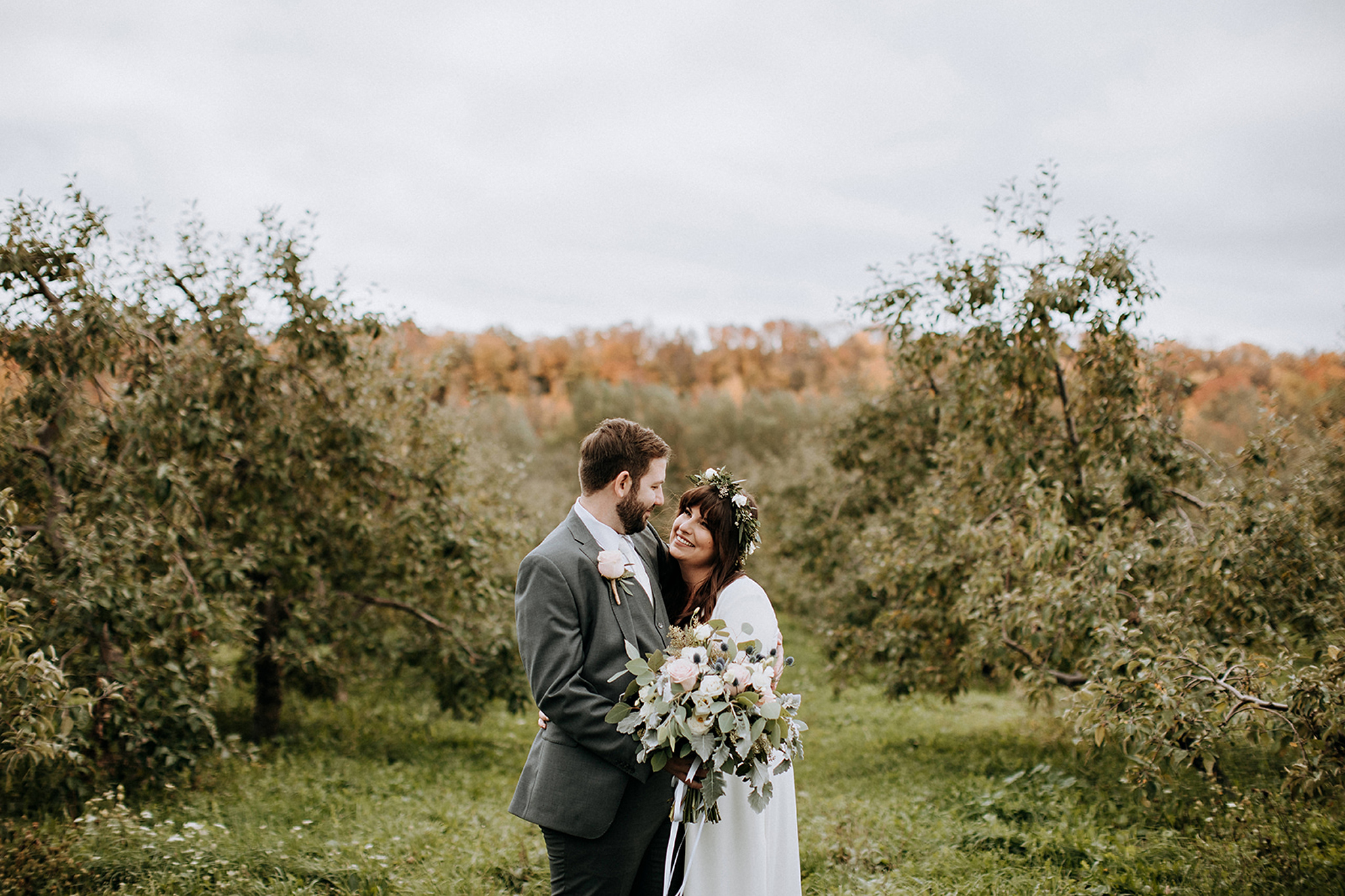 cozy couples portrait in apple orchard at meaford barn wedding