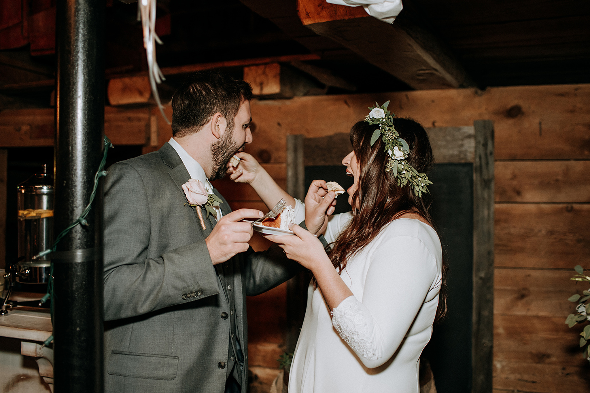 couple feeding each other cake at meaford barn wedding