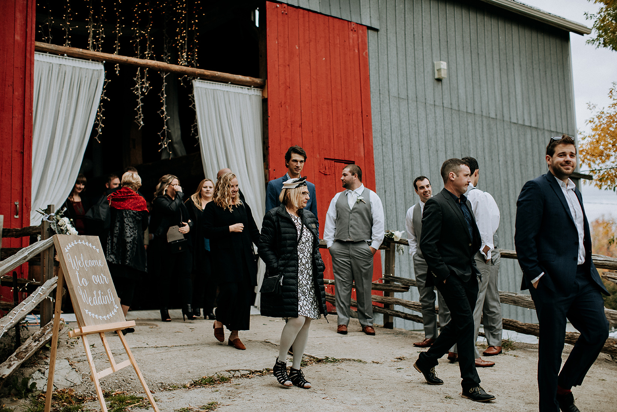 guests head to outdoor ceremony at meaford barn wedding