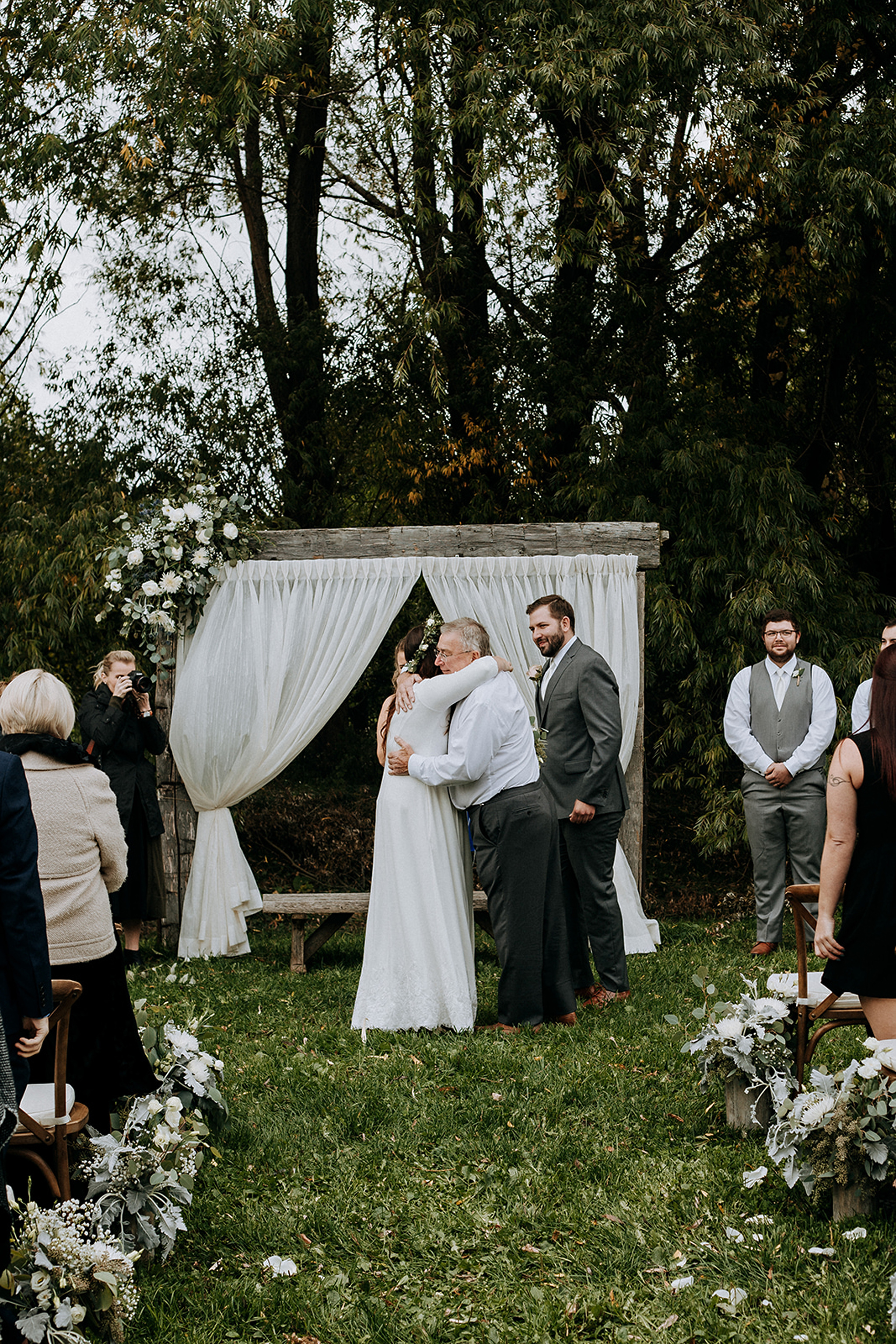 bride hugs father at outdoor cermeony in meaford