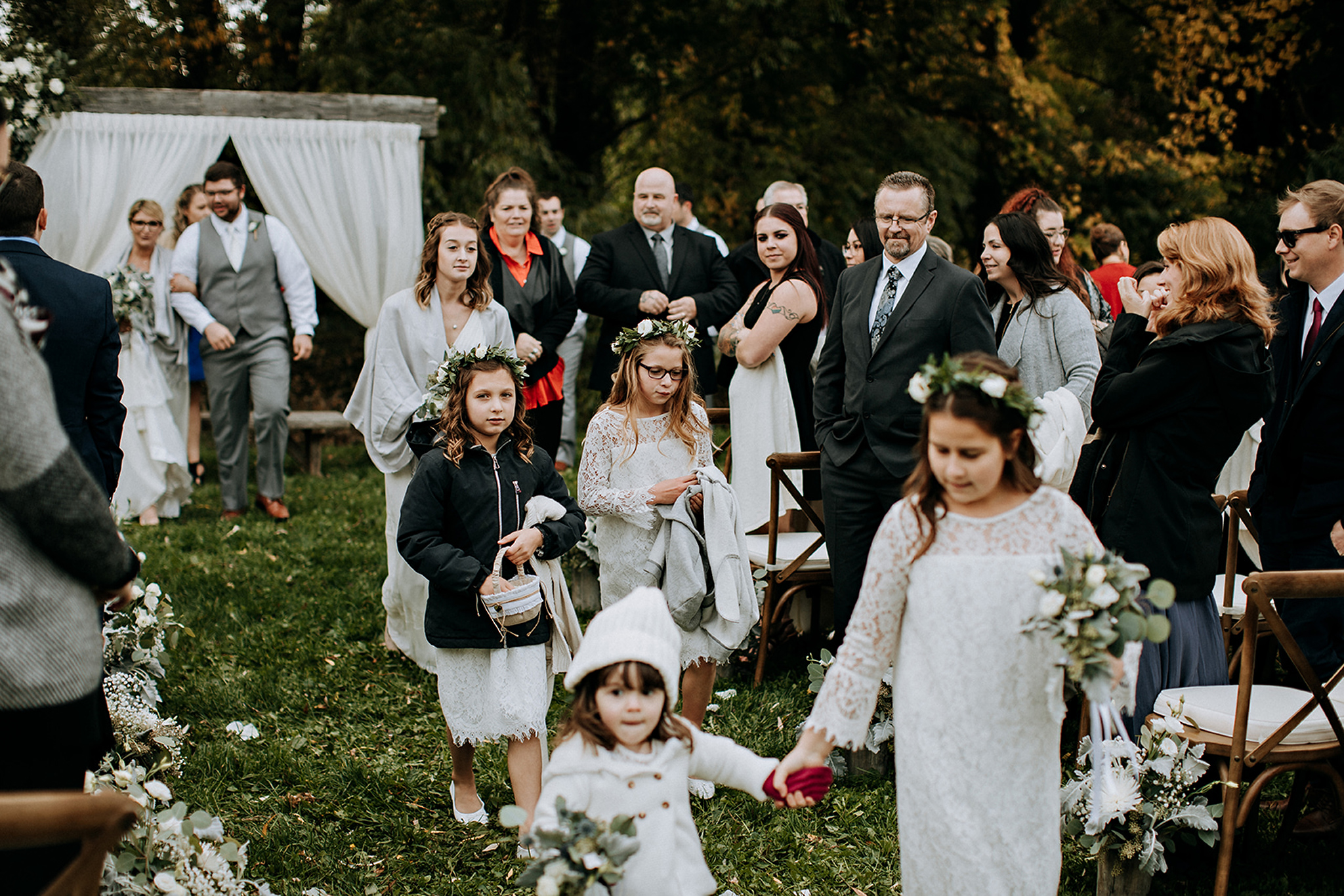 wedding party exits outdoor ceremony at meaford barn wedding