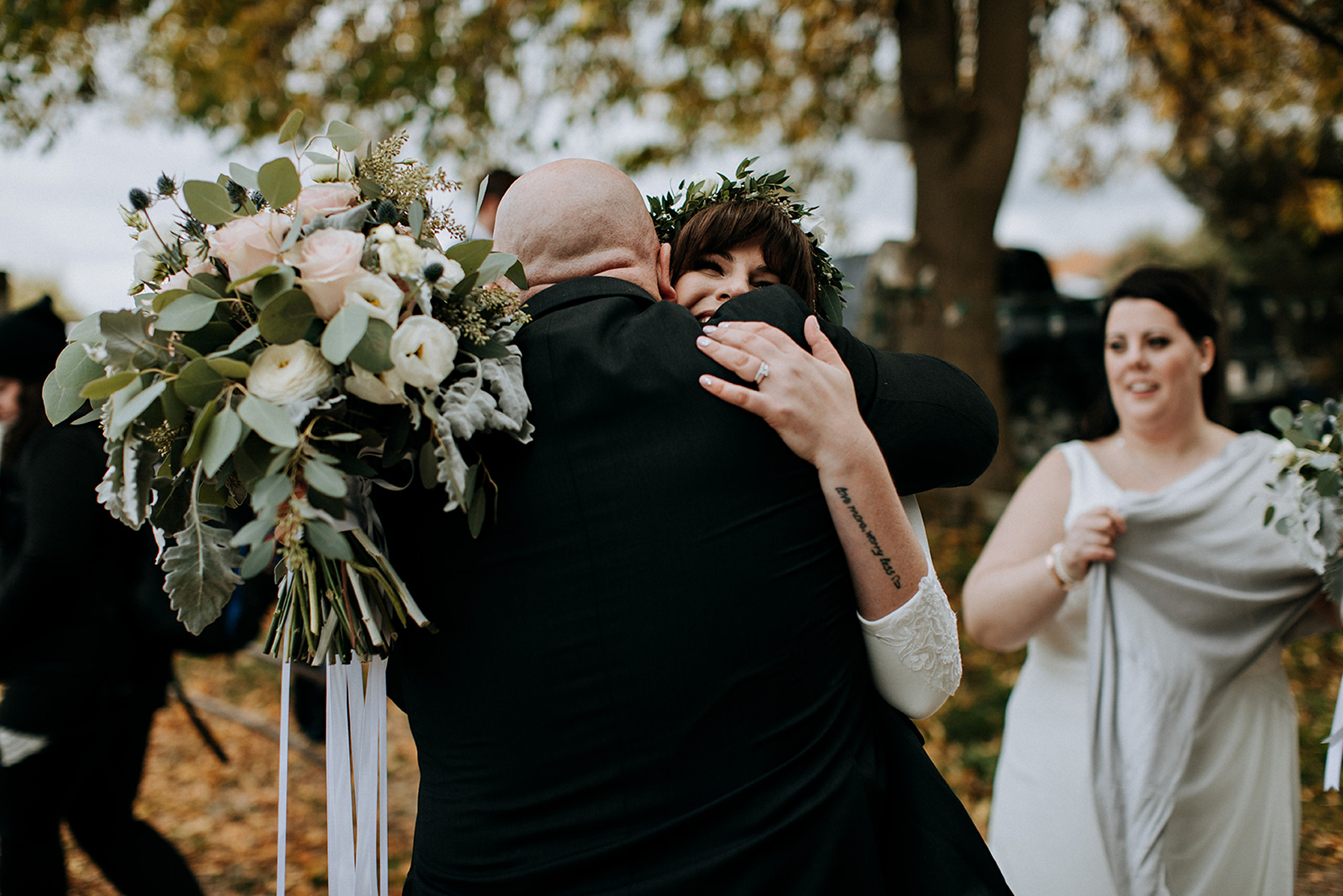 congratulatory hugs after outdoor wedding ceremony in meaford