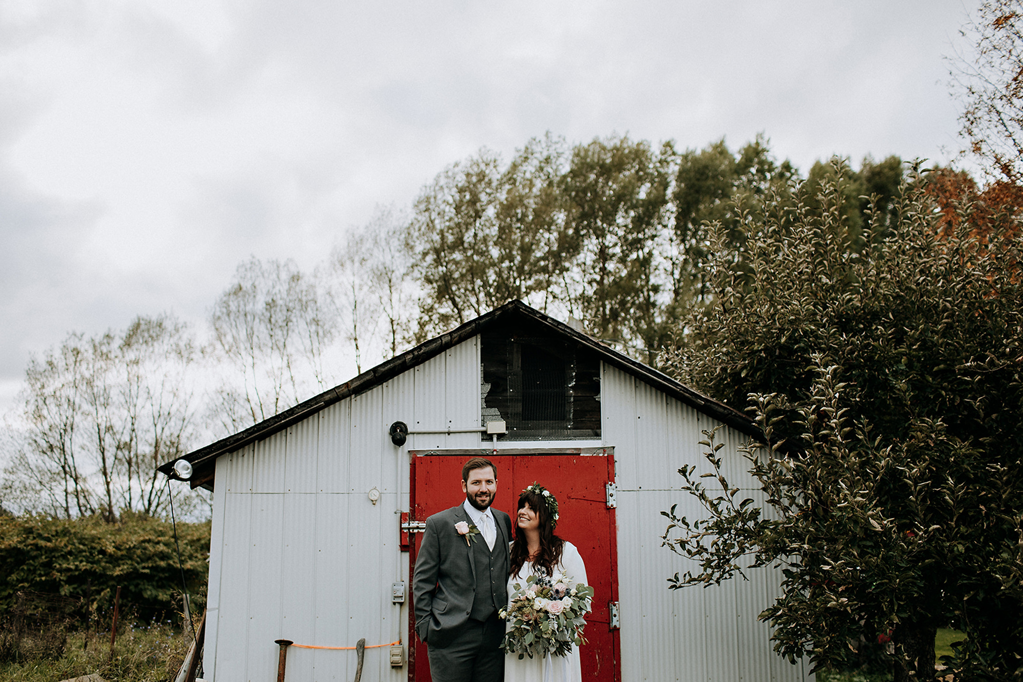 bride and groom with red door at meaford barn wedding