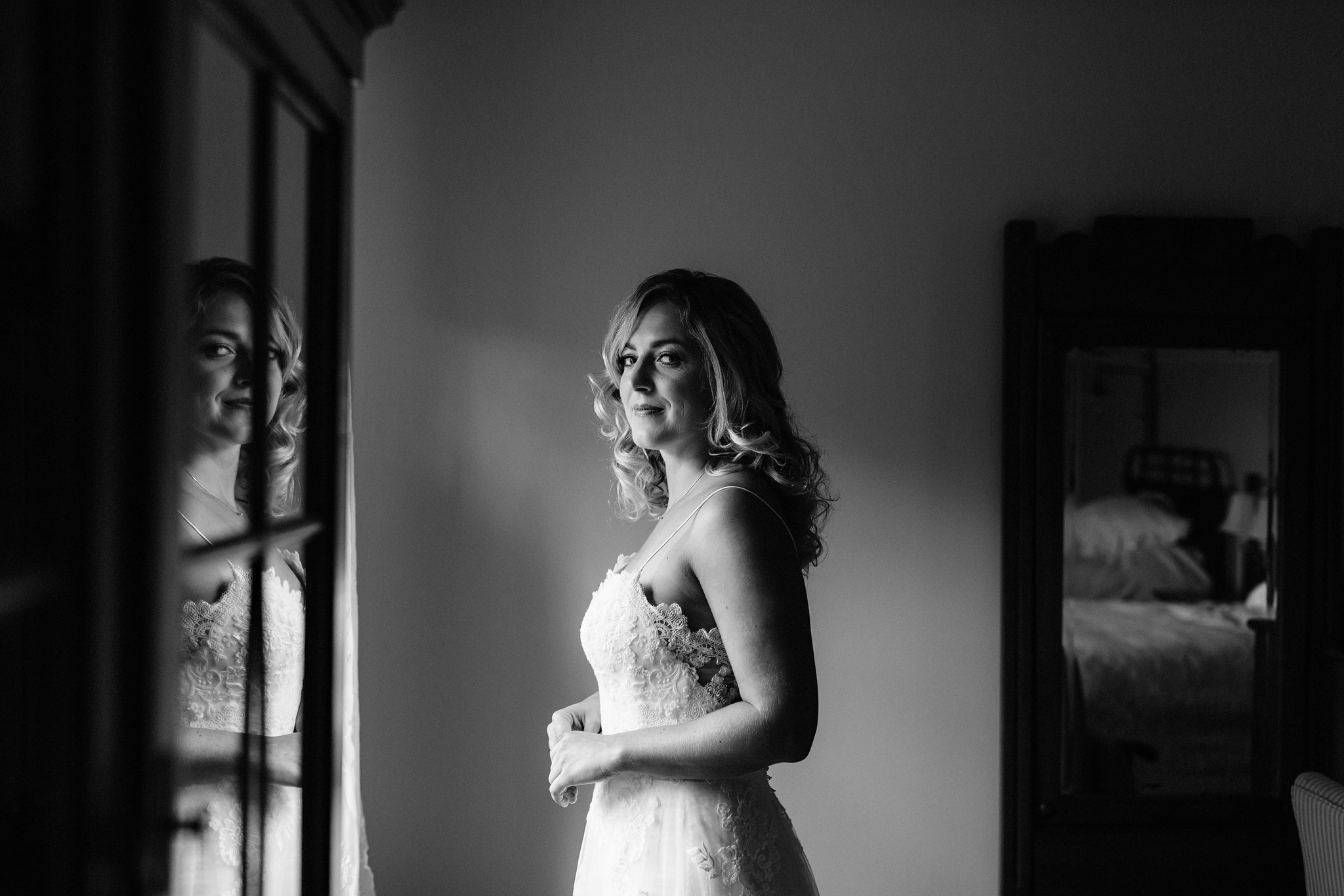Bride and her reflection at the bnb at Coffin Ridge Boutique Win