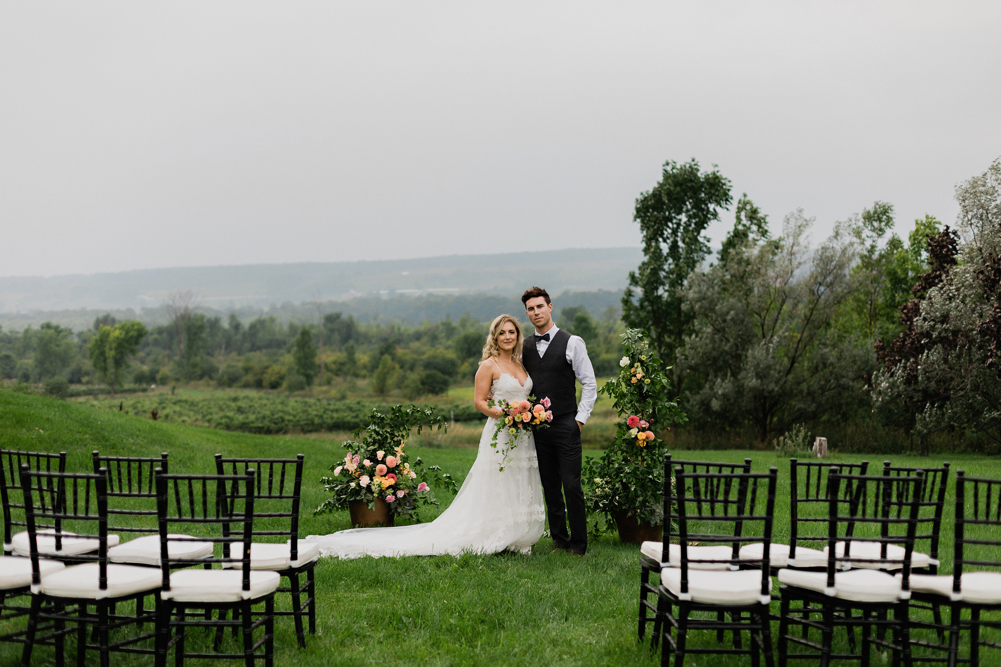 Bridge and groom at ceremony site with sweeping landscape at Cof