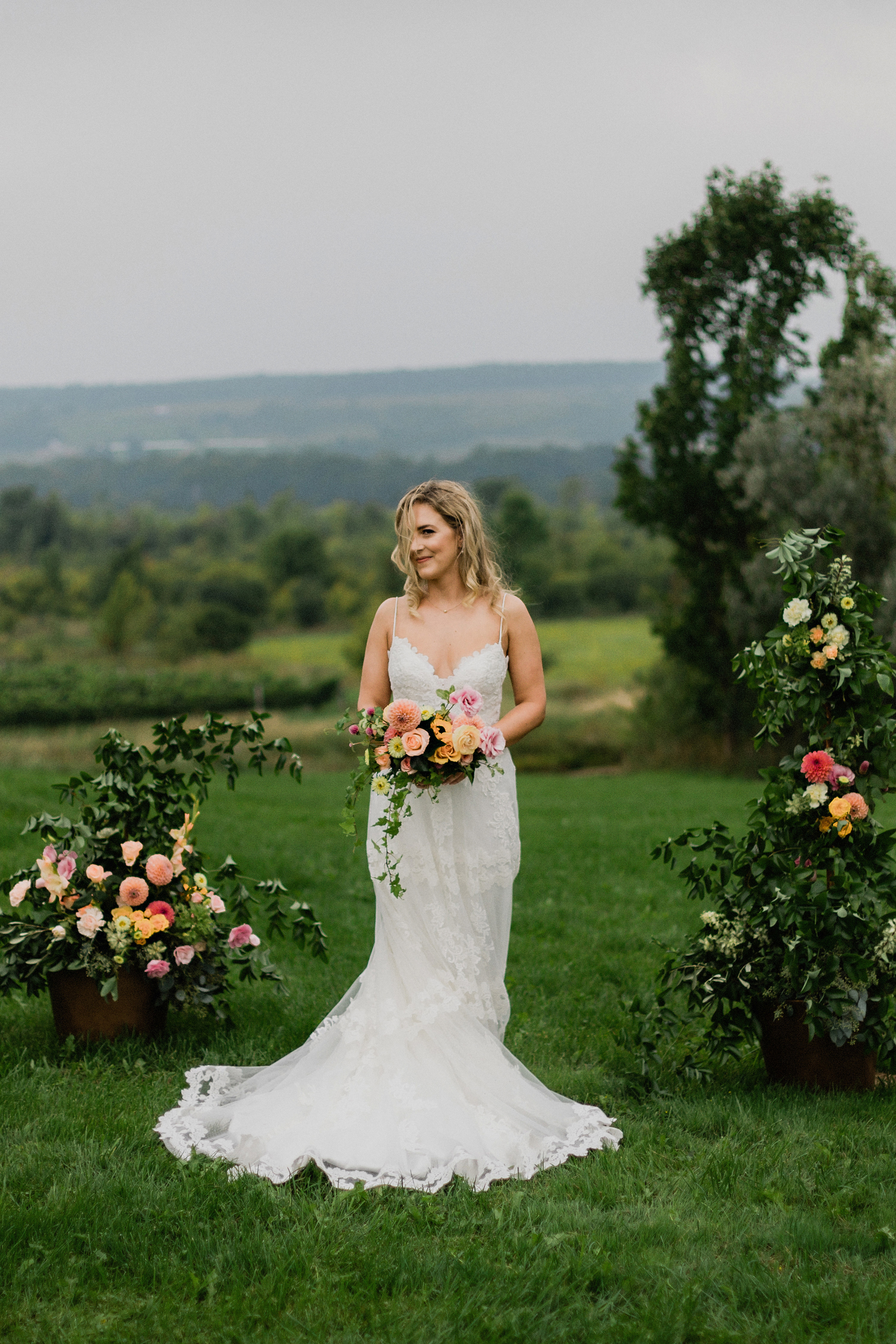 Bride with lace gown and natural wavy hair at Coffin Ridge Bouti