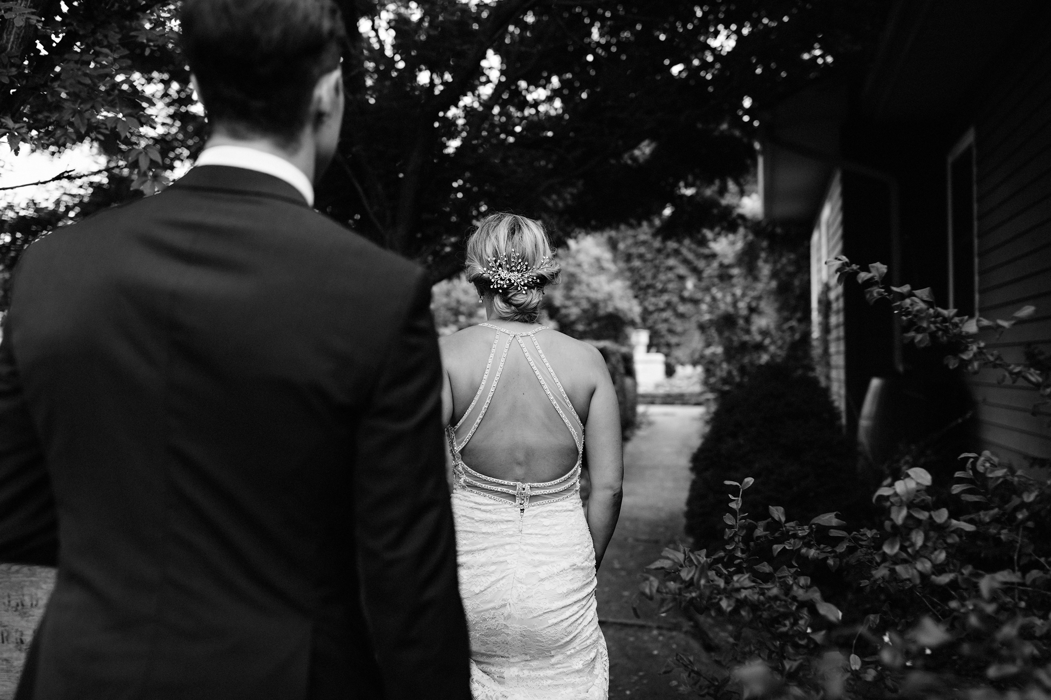 Bride and groom head to the gardens at Coffin Ridge Boutique Win
