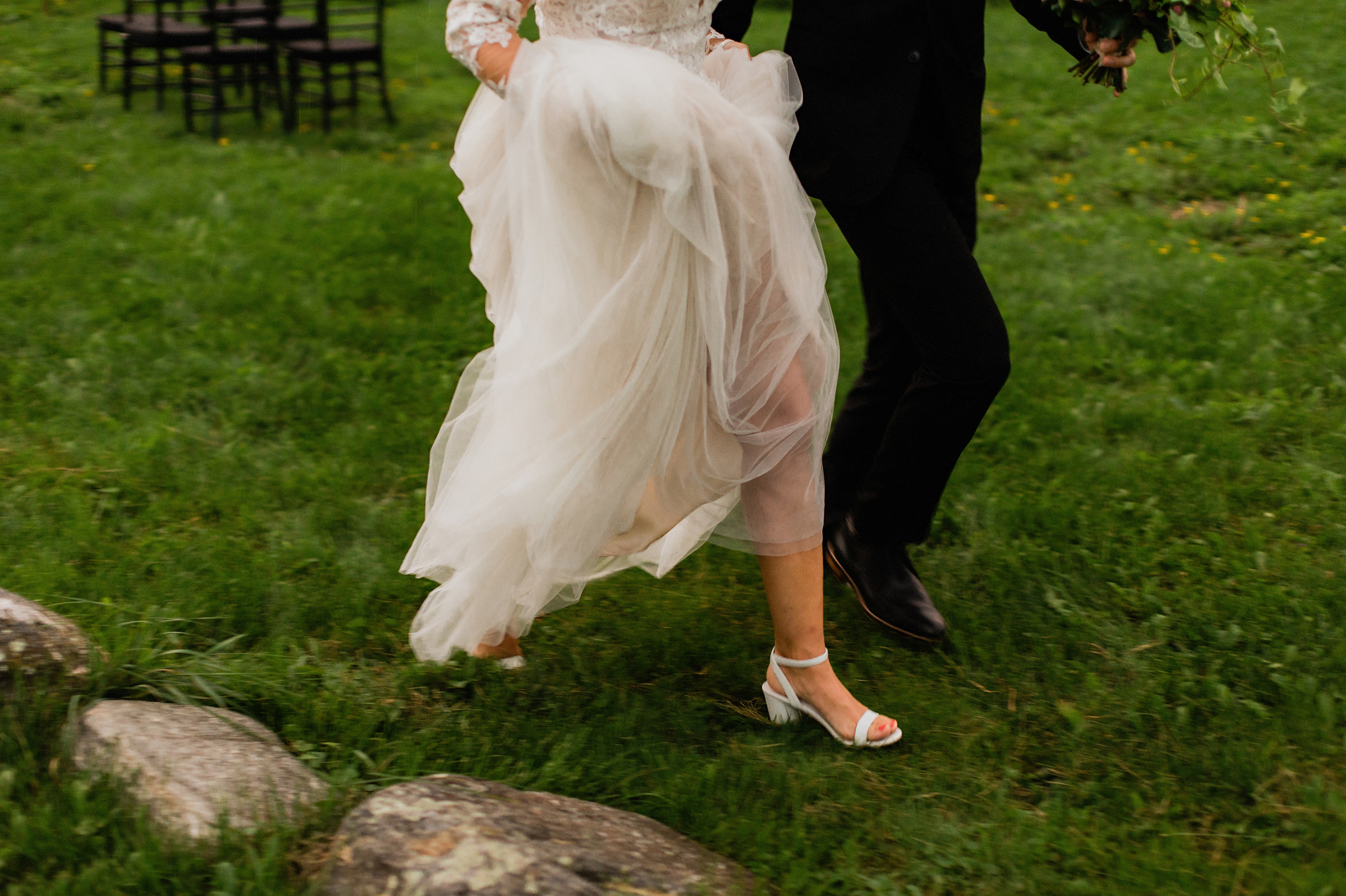 Bride and groom run to beat the rain at Coffin Ridge Boutique Wi
