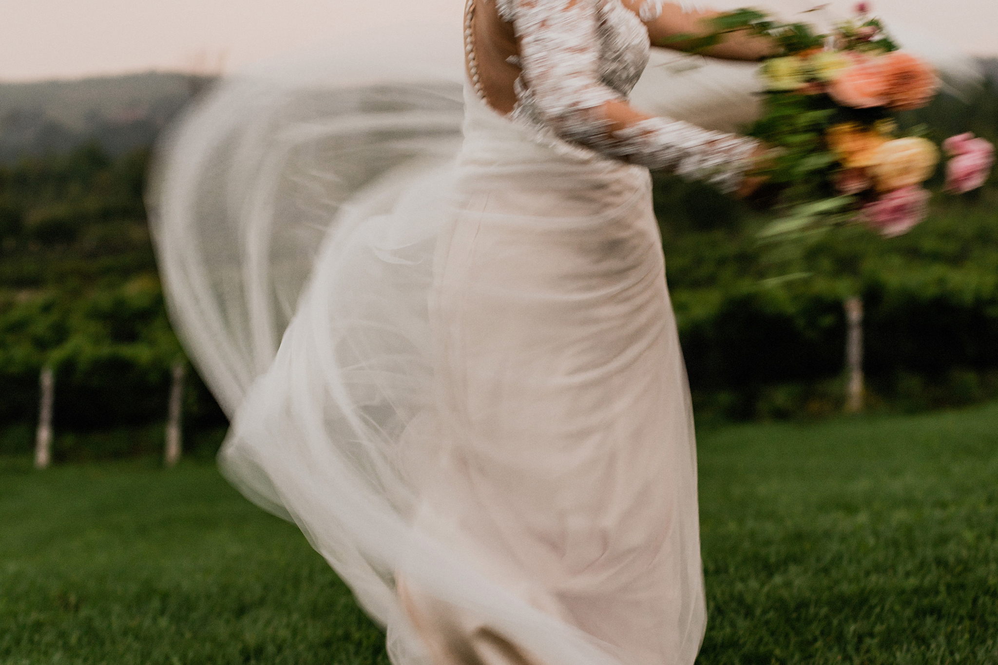 Bride swishes her chiffon and lace gown at Coffin Ridge Boutique