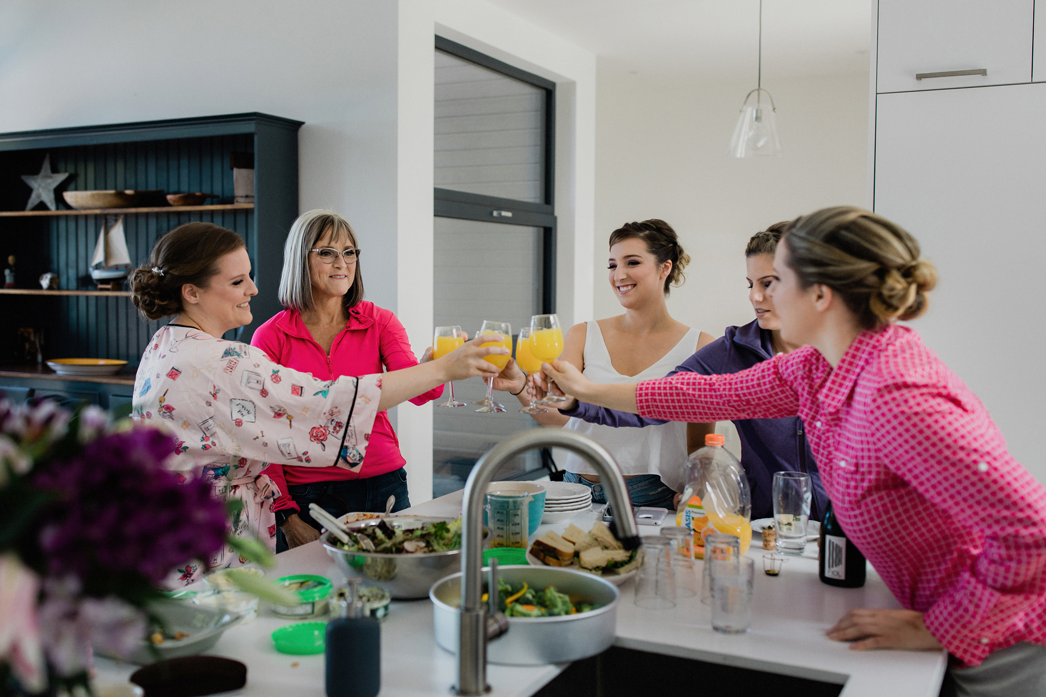 bridal party toast with mimosas