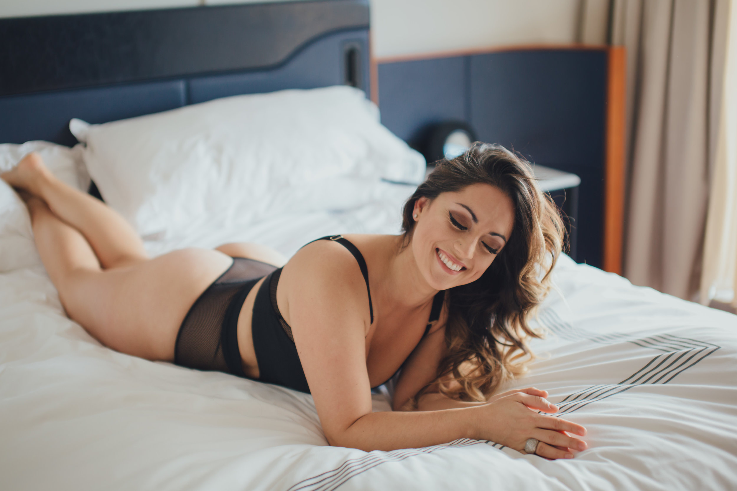 Blanca*  - I like this photo because of the smile on her face. Boudoir is a funny and often taboo idea. But the positive energy and increase in self-esteem that I have seen come out of these shoots, justifies 100+ more to come. EVERY. SINGLE. WOMAN. is self conscious of her body. I don't care if she's skinny, fat, tone or soft she has a problem area that is multiplied in her head. However, something about the magic of being vulnerable, showing up to a hotel to get your hair and make up done, and putting on something that makes you feel like a fierce vixen is confidence boosting. The cards and texts and GIFTS (GIFTS!) I have received from clients after a shoot thanking me for making them feel the way I did and portraying them in a way they thought was only possible in their imagination makes my heart explode. That is literally all I could dream to do for them and at the end of the day, I want them to leave with this smile.     *All boudoir photos I post or share have the consent of the individual. Peoples privacy and security is my number one priority and I'd never compromise that.