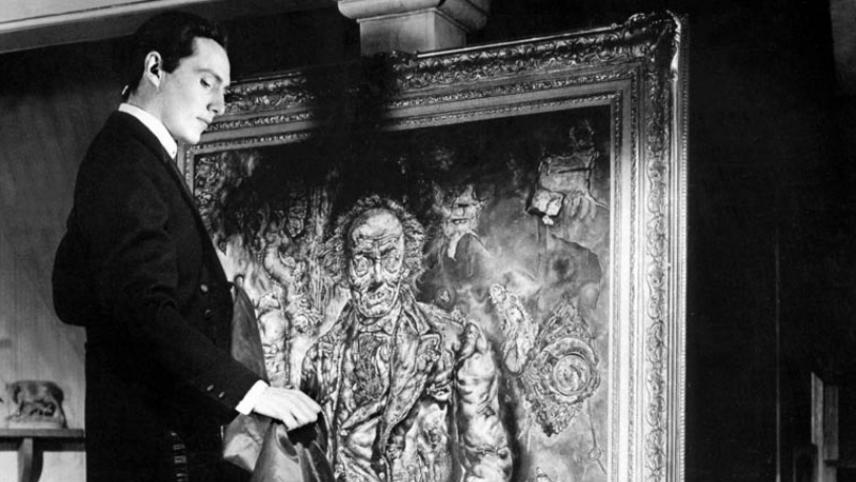 Still from the 1945 Hollywood version of Oscar Wilde's  The Picture of Dorian Gray.    The   original oil painting by Ivan Albright  , commissioned for the movie and filmed, in stages, to mirror the protagonist's decline into decay and depravity over time, is part of the permanent collection of the Art Institute of Chicago.