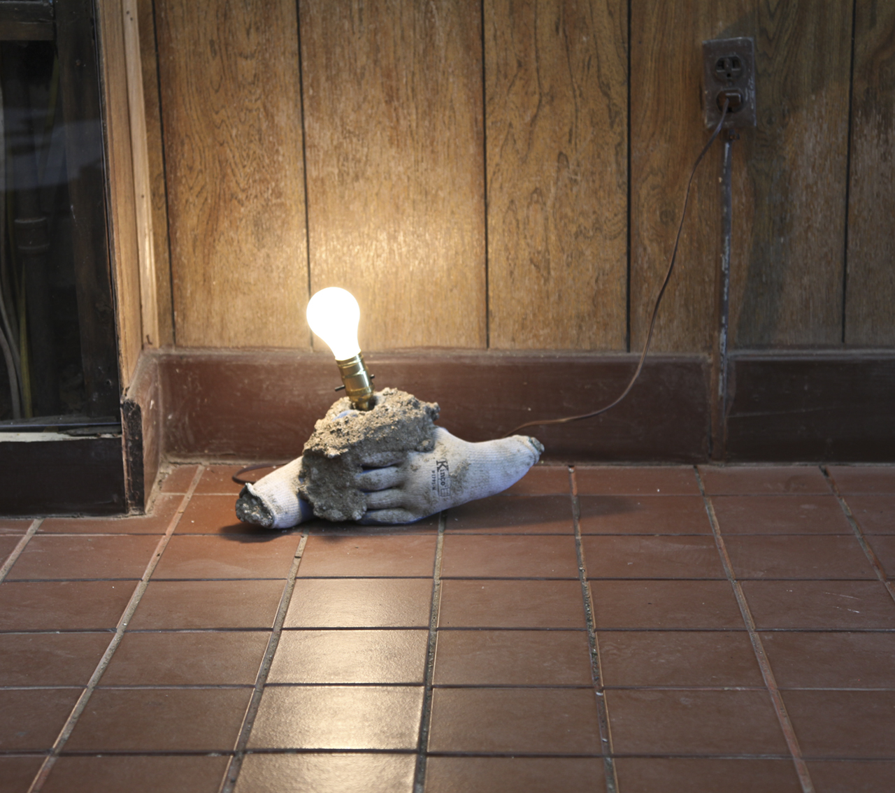 "Daniel Glendening ""Nine nights out of ten aren't dark enough"" concrete, gloves, wiring, lightbulb 2018"